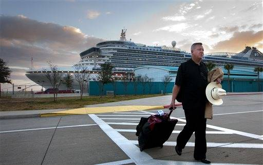 Jack Doebbler walks to his vehicle after getting off the Caribbean Princess cruise ship, Friday, Jan. 31, 2014, in La Porte, Texas. The ship returned to port early on Friday due to a dense fog advisory and not because people were vomiting and had diarrhea, a Princess Cruises spokeswoman said Friday. But passengers said the crew announced on the second day of the cruise that people were sick, apparently with highly contagious norovirus, and that extra precautions were being taken to ensure it didn't spread.