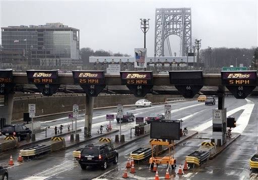 "This photo shows traffic passing through the toll booths at the George Washington Bridge, in Fort Lee, N.J. Gov. Chris Christie made inaccurate statements during a news conference about the lane closures near the George Washington Bridge, according to a letter released Friday, Jan. 31, 2014, by a lawyer for a former Christie loyalist who ordered the closures and resigned amid the ensuing scandal that has engulfed the New Jersey governor's administration. In the letter, David Wildstein's lawyer said his client ""contests the accuracy of various statements that the governor made about him and he can prove the inaccuracy of some."""