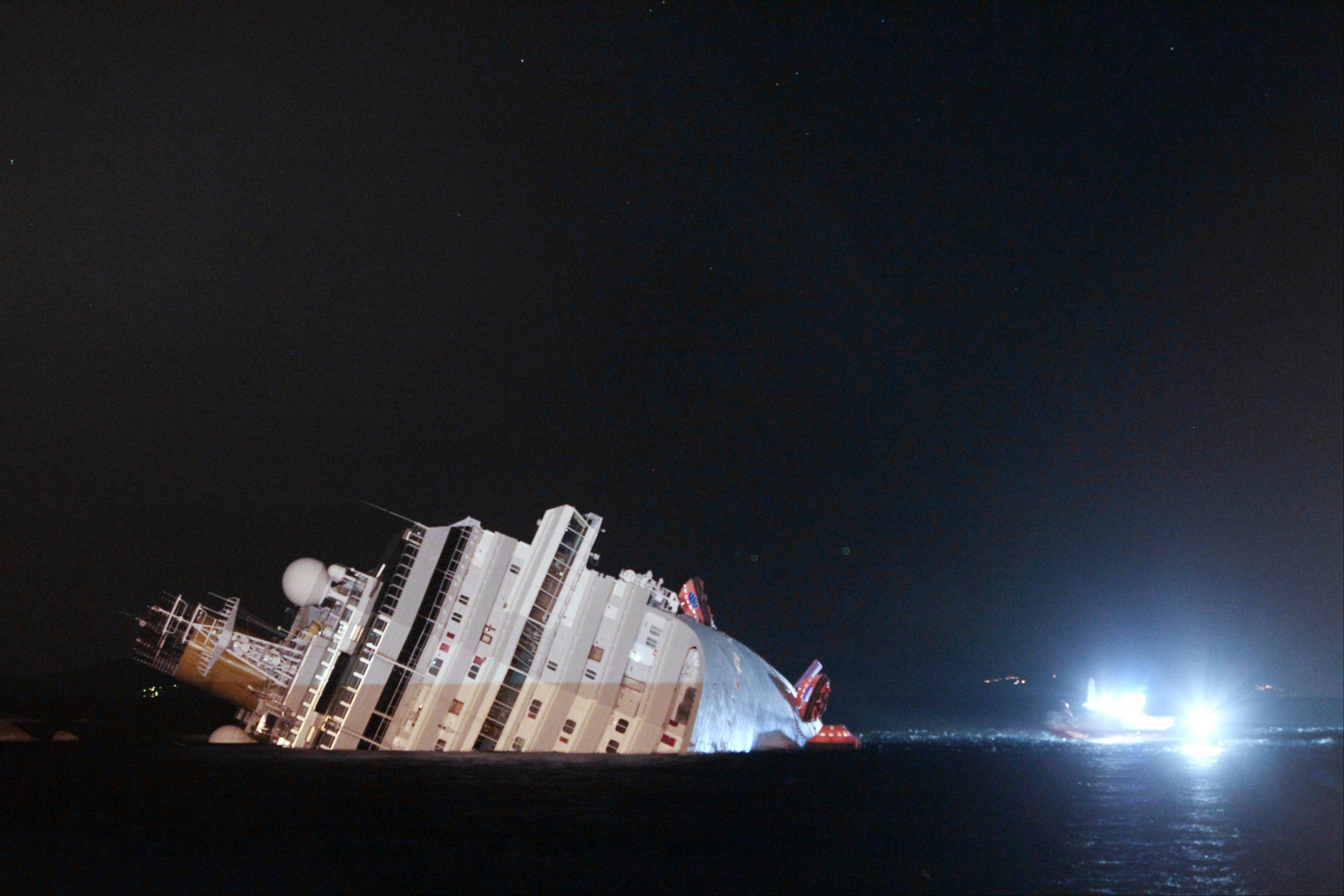 The luxury cruise ship Costa Concordia leans on its side after running aground near the tiny Tuscan island of Giglio, Italy, on Jan. 14, 2012.