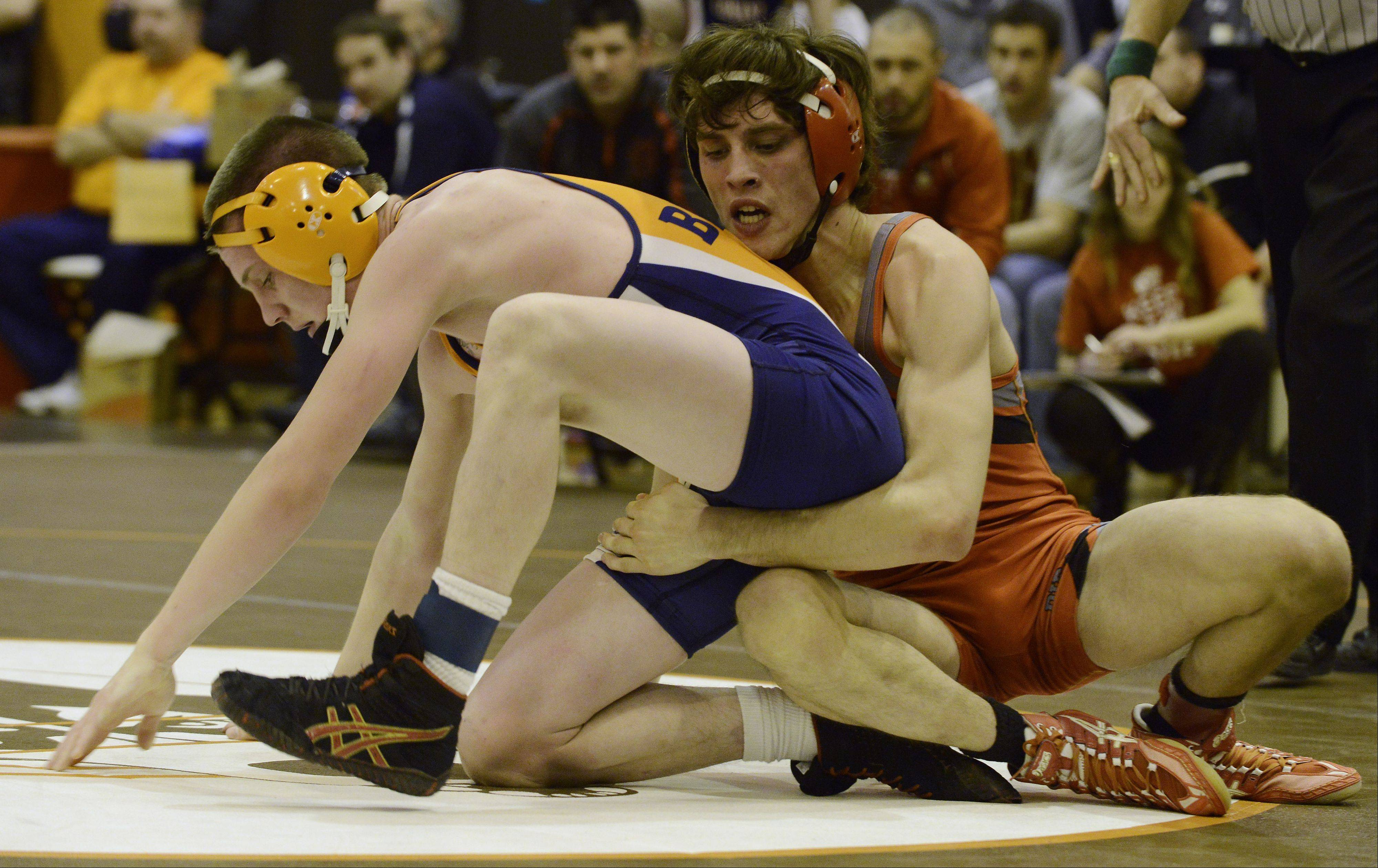 Buffalo Grove's Chase Ori, left, and Palatine's Juan Guajardo wrestle in the 126-pound finals during the Mid-Suburban League meet at Hersey on Saturday.