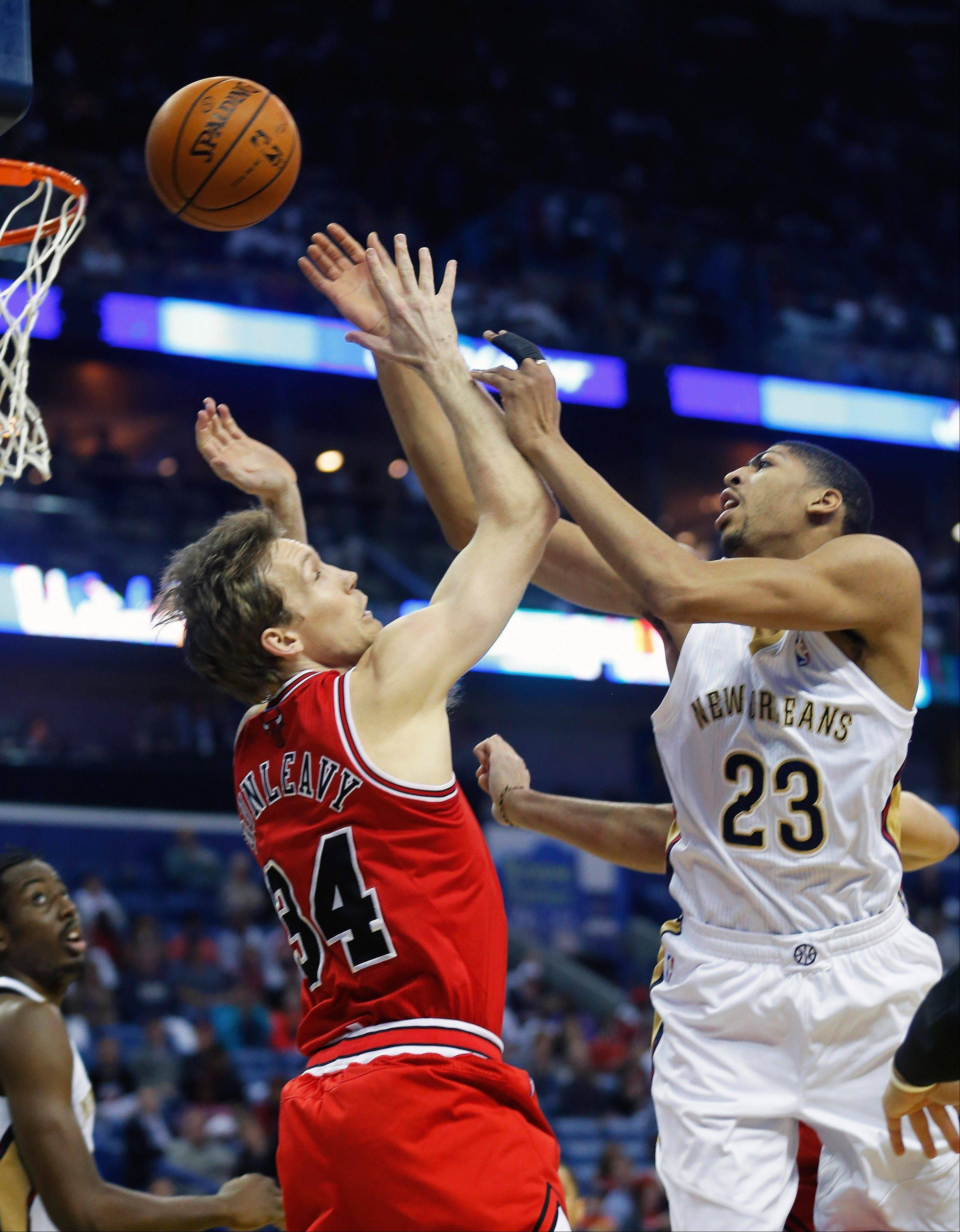 The Pelicans� Anthony Davis drives against Mike Dunleavy of the Bulls during the first half Saturday in New Orleans.