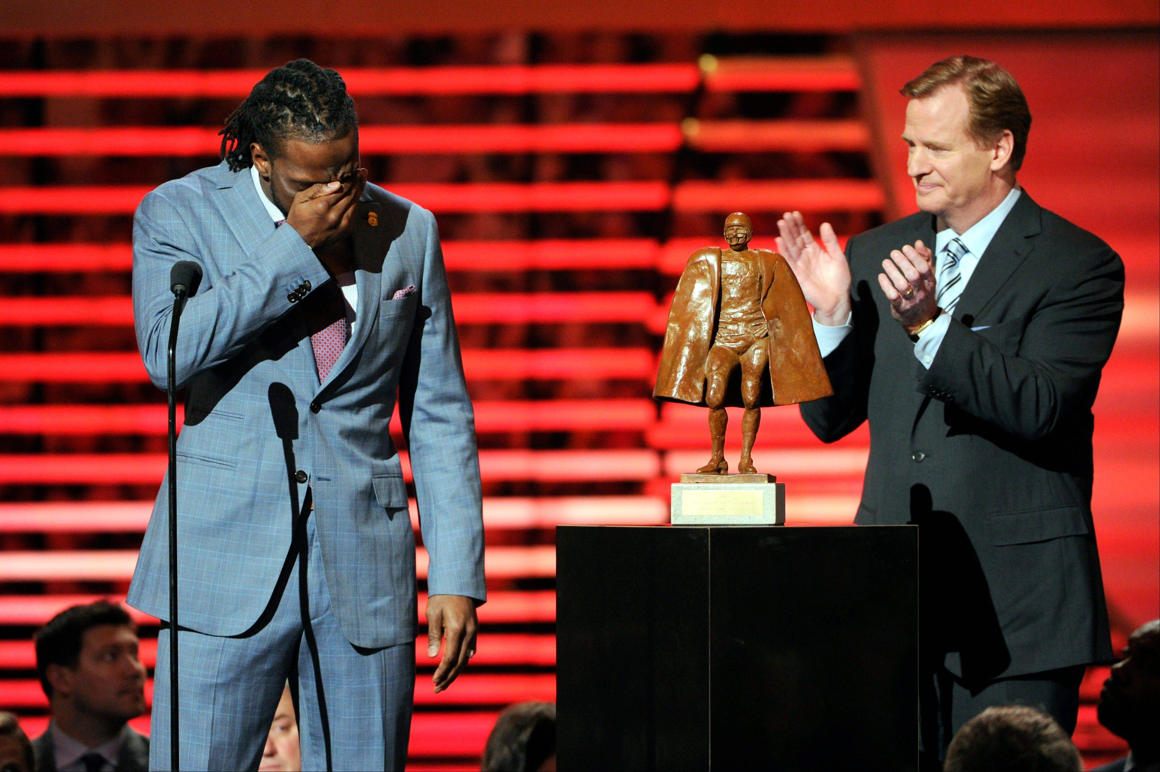"Charles ""Peanut"" Tillman of the Chicago Bears, left, accepts the award for Walter Payton NFL Man of the Year from NFL Commissioner Roger Goodell at the annual NFL Honors at Radio City Music Hall."