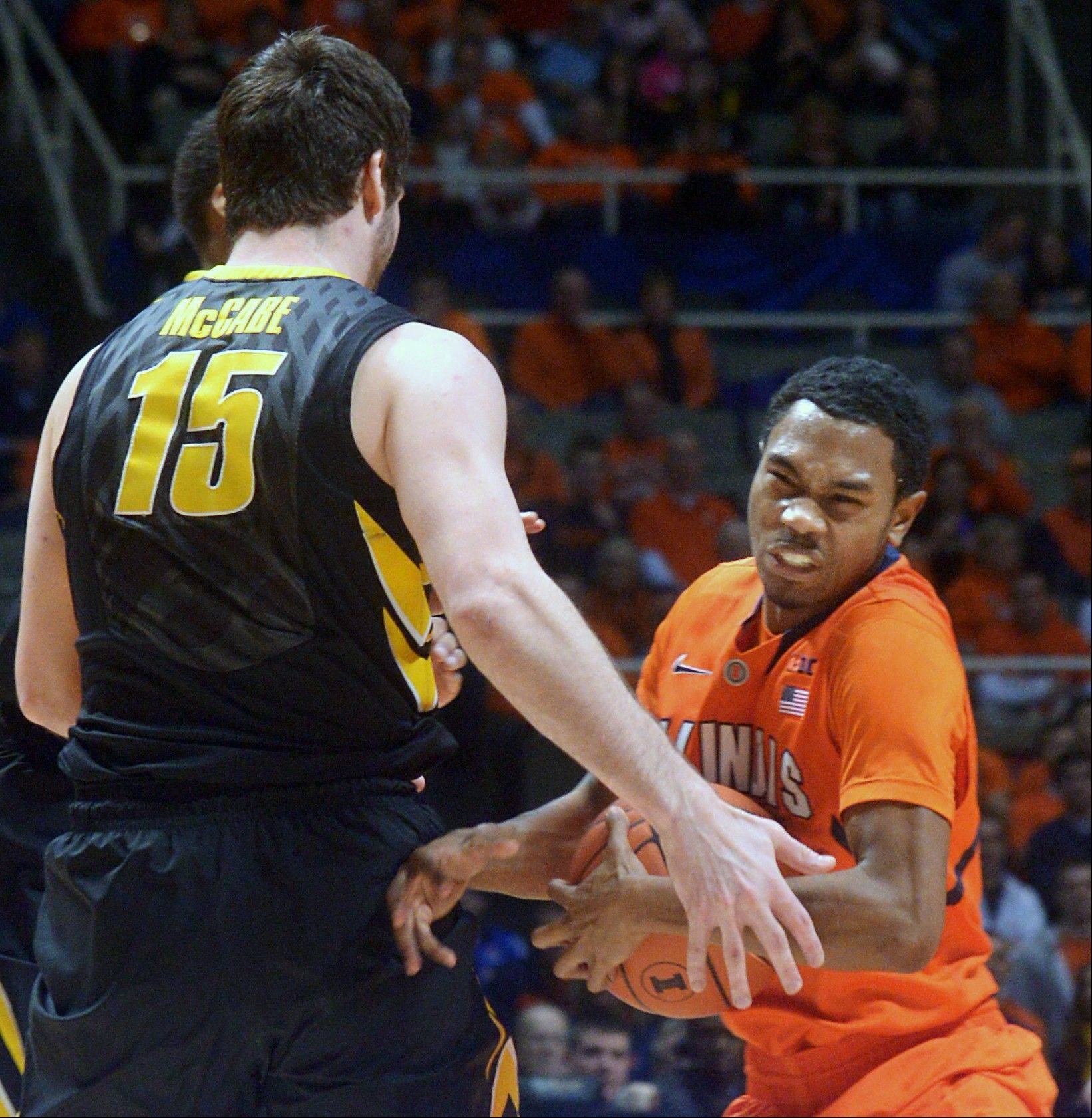 Illinois� Jaylon Tate (1) tries to keep the ball away from Iowa�s Zach McCabe (15) during Saturday night�s game in Champaign. The Illini lost 81-74.