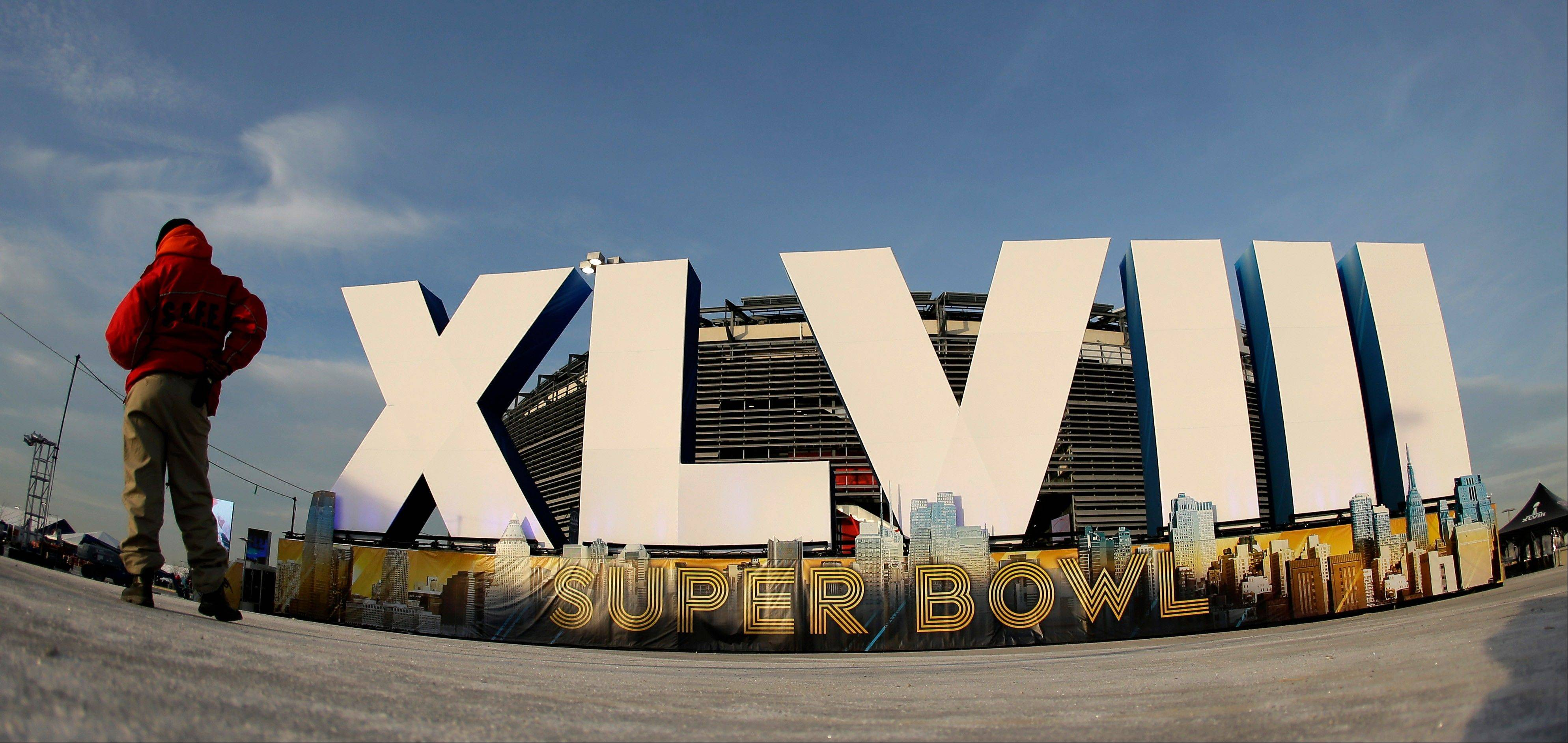 A security guard stands by a sign for NFL football�s Super Bowl XLVIII stands in front of MetLife Stadium Sat. Feb. 1, 2014, in East Rutherford, N.J. The stadium will be the site of Sunday�s championship game between the Denver Broncos and the Seattle Seahawks.