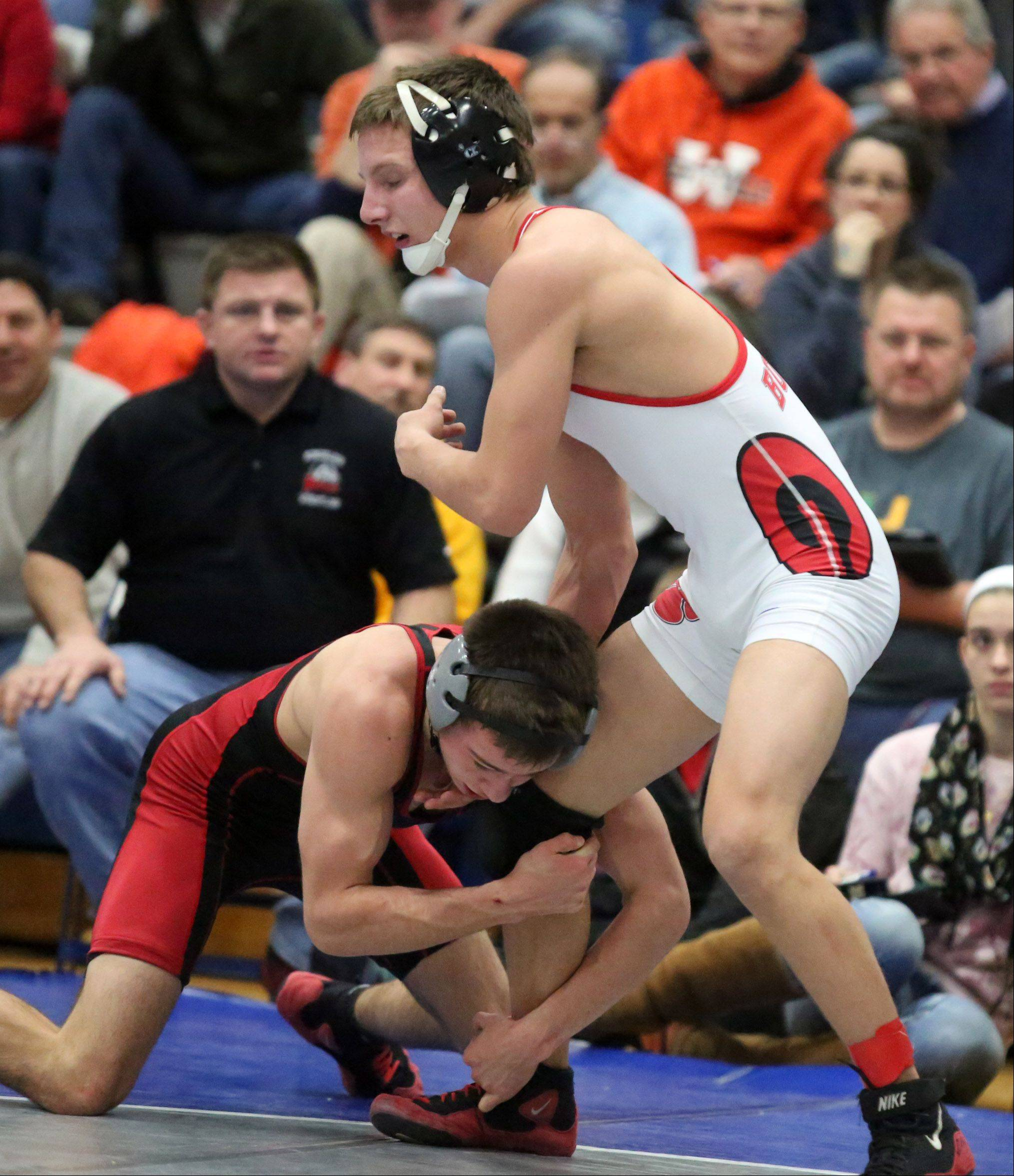Grant�s Troy Parent, standing, wins the 132-pound final against Mundelein�s Sam Riportella in the North Suburban Conference meet on Saturday at Vernon Hills.