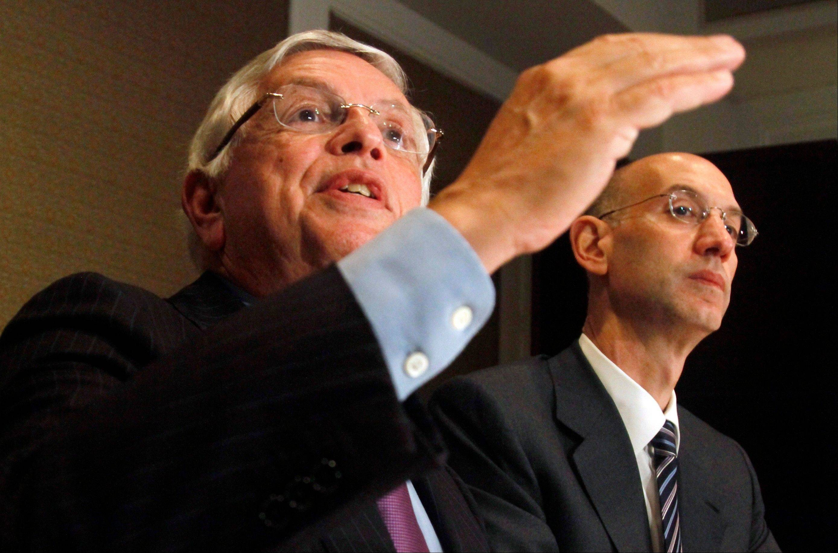 David Stern, left, has retired as NBA commissioner, putting Adam Silver, right, in charge.