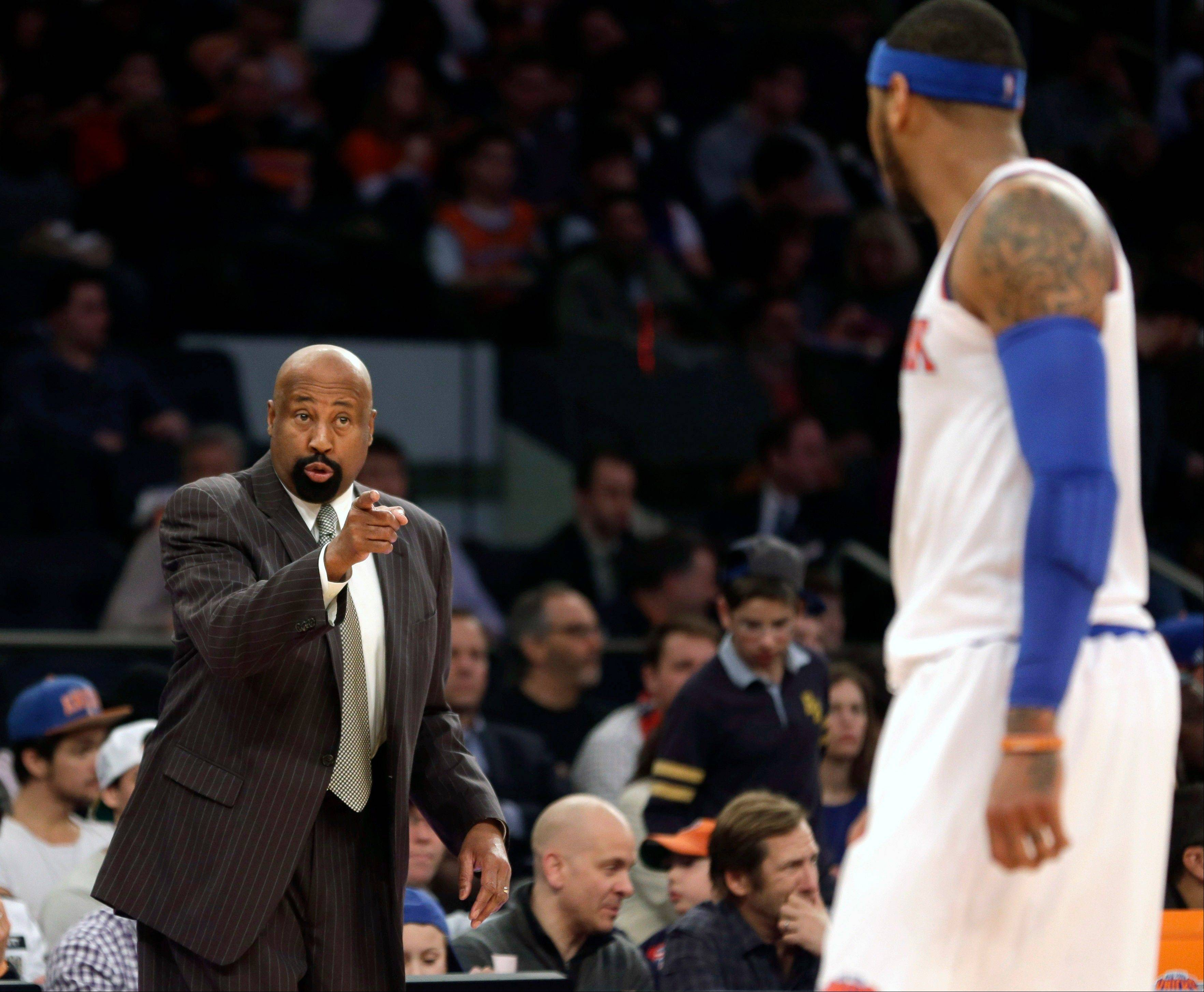 New York Knicks' head coach Mike Woodson, left, talks with Carmelo Anthony during the second half of an NBA basketball game at Madison Square Garden, Sunday, Jan. 26, 2014, in New York. The Knicks defeated the Lakers 110-103.