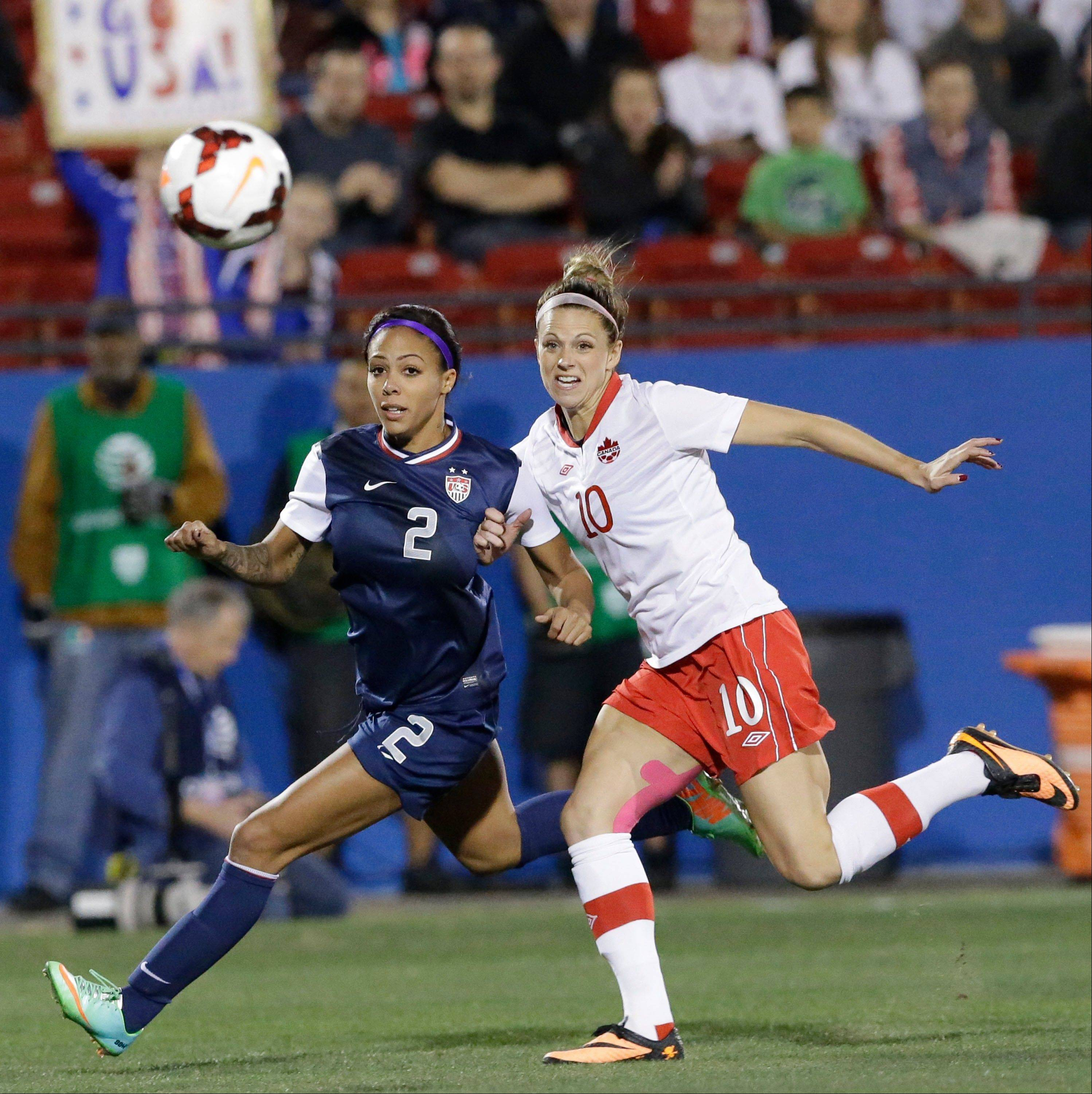 U.S. forward Sydney Leroux, left, and Canada defender Lauren Sesselmann chase the ball during the first half of a Friday�s game in Frisco, Texas. The United States won 1-0.