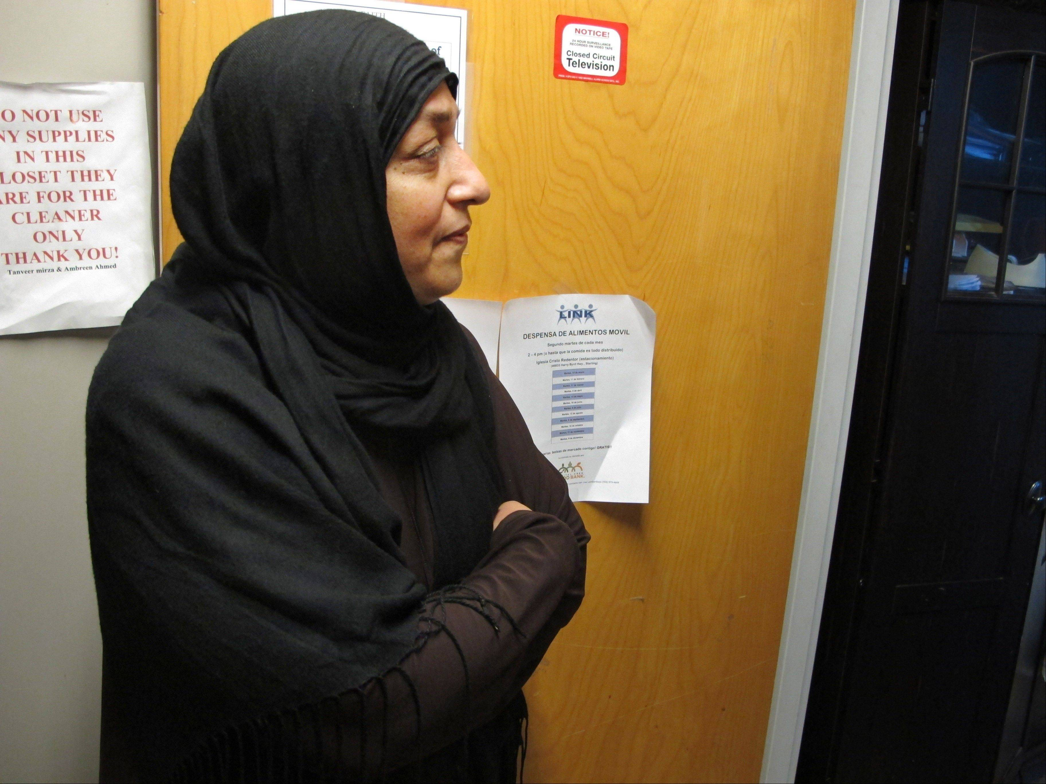 Tanveer Mirza stands in the FAITH Social Services offices in Herndon, Va. Mirza emigrated from Pakistan 37 years earlier. In 1999 her mosque started this effort to assist refugees from the civil war in Bosnia who were being resettled in Northern Virginia.