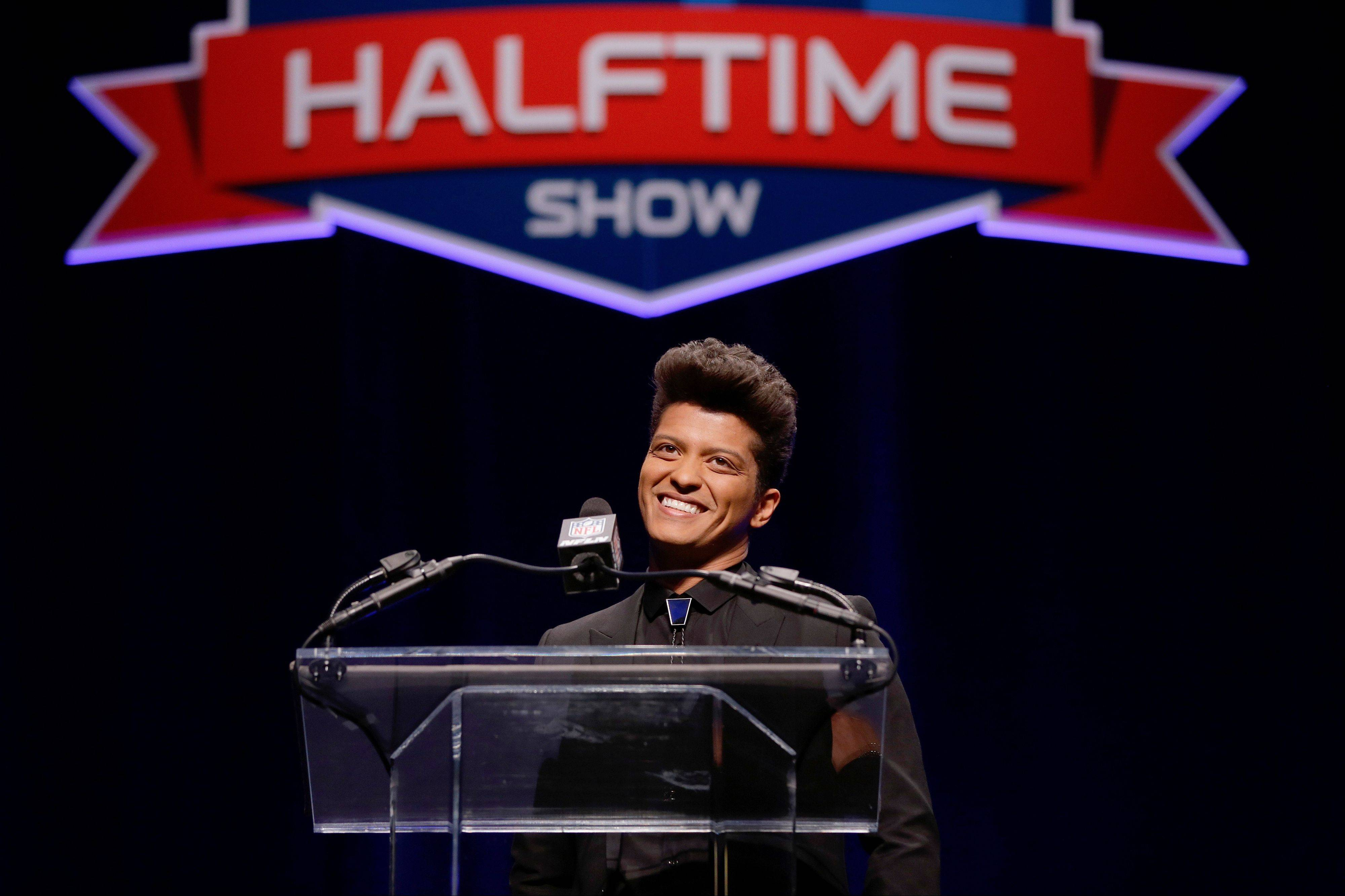Bruno Mars, who will headline the half-time show at the NFL Super Bowl XLVIII, speaks during a press conference Thursday in New York.