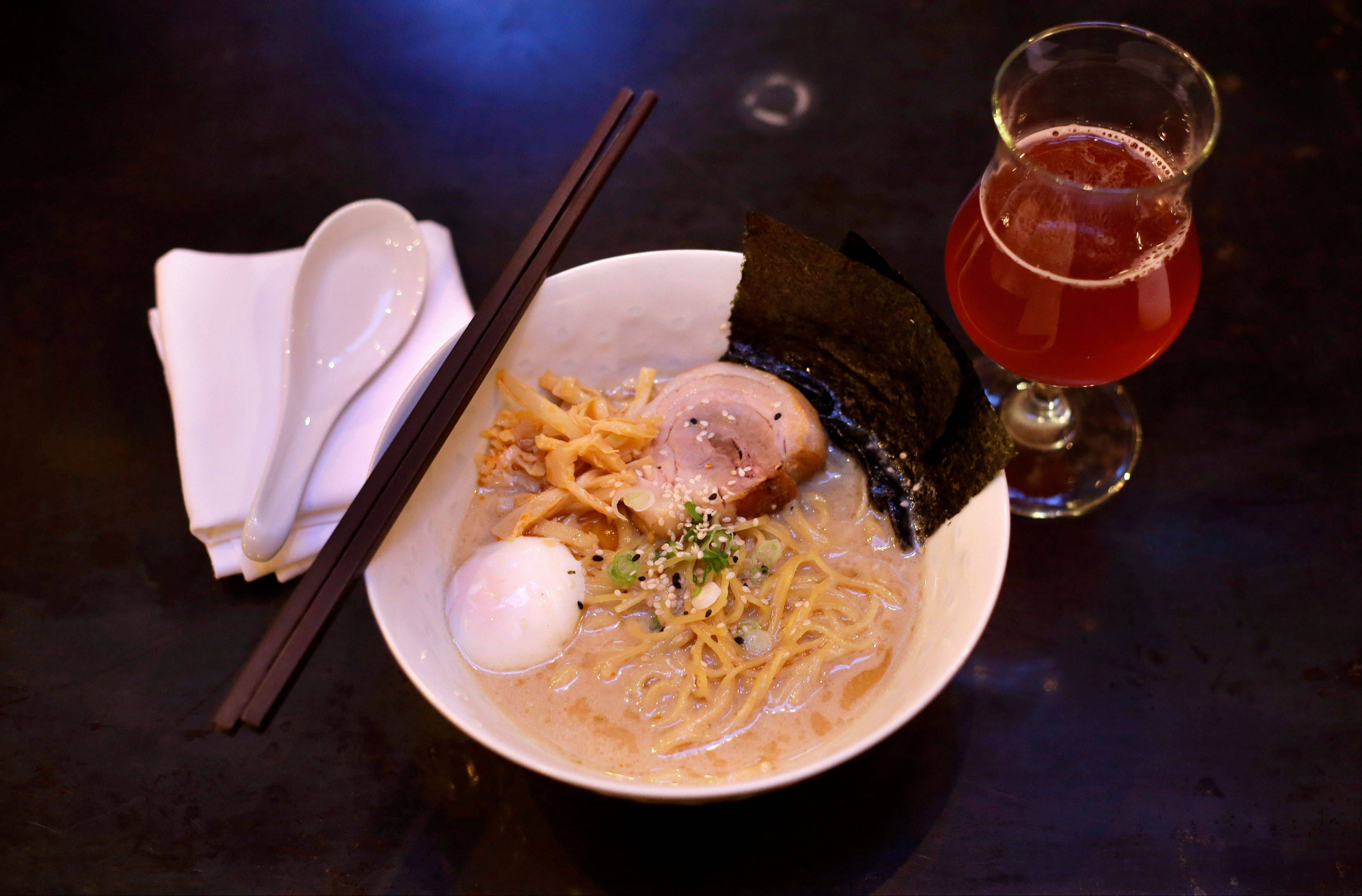 Patrons come to backbar to grab a bowl of ramen noodles and a glass of beer at backbar in Somerville, Mass.