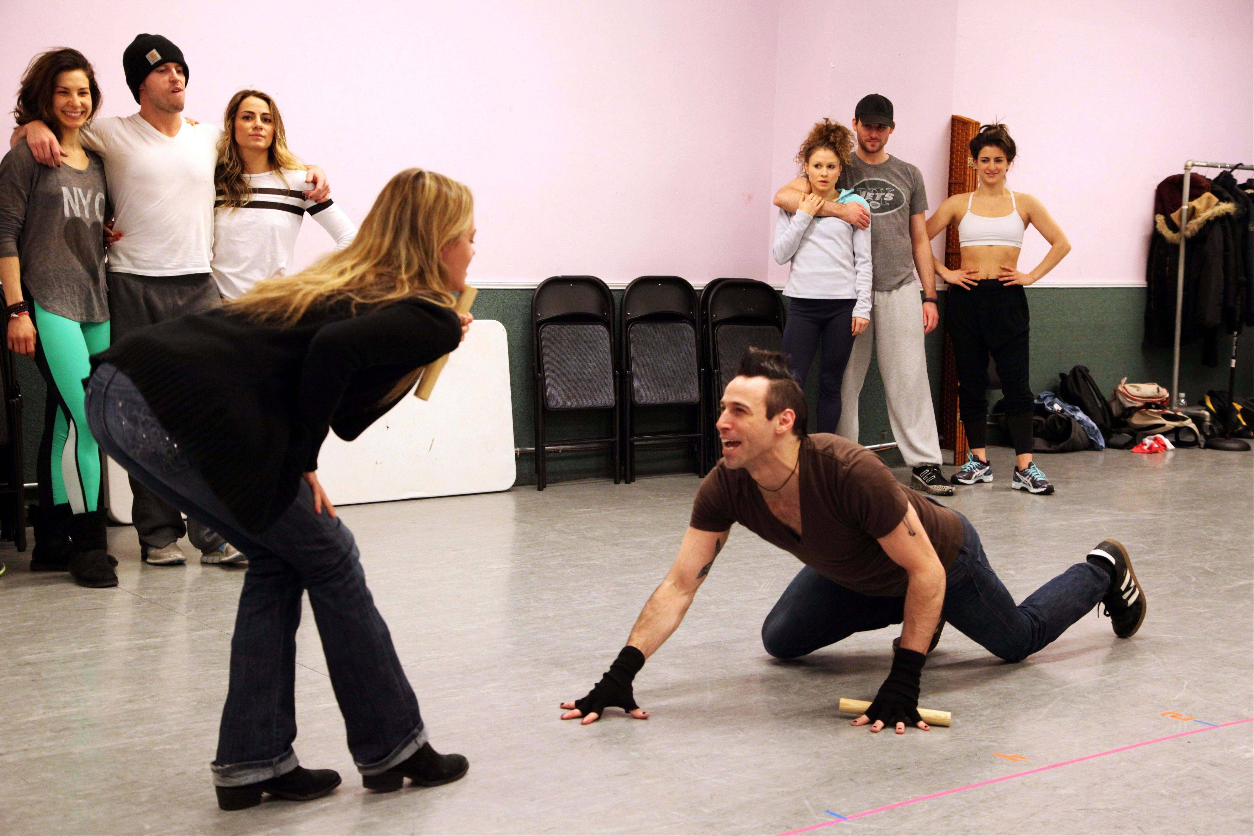 "Kate Rockwell, left, and Joey Calveri rehearse a scene from ""Rock of Ages"" at a dance studio in New York. The cast of the Broadway show will be part of the televised pregame entertainment from outside MetLife Stadium in New Jersey for Sunday's Super Bowl."