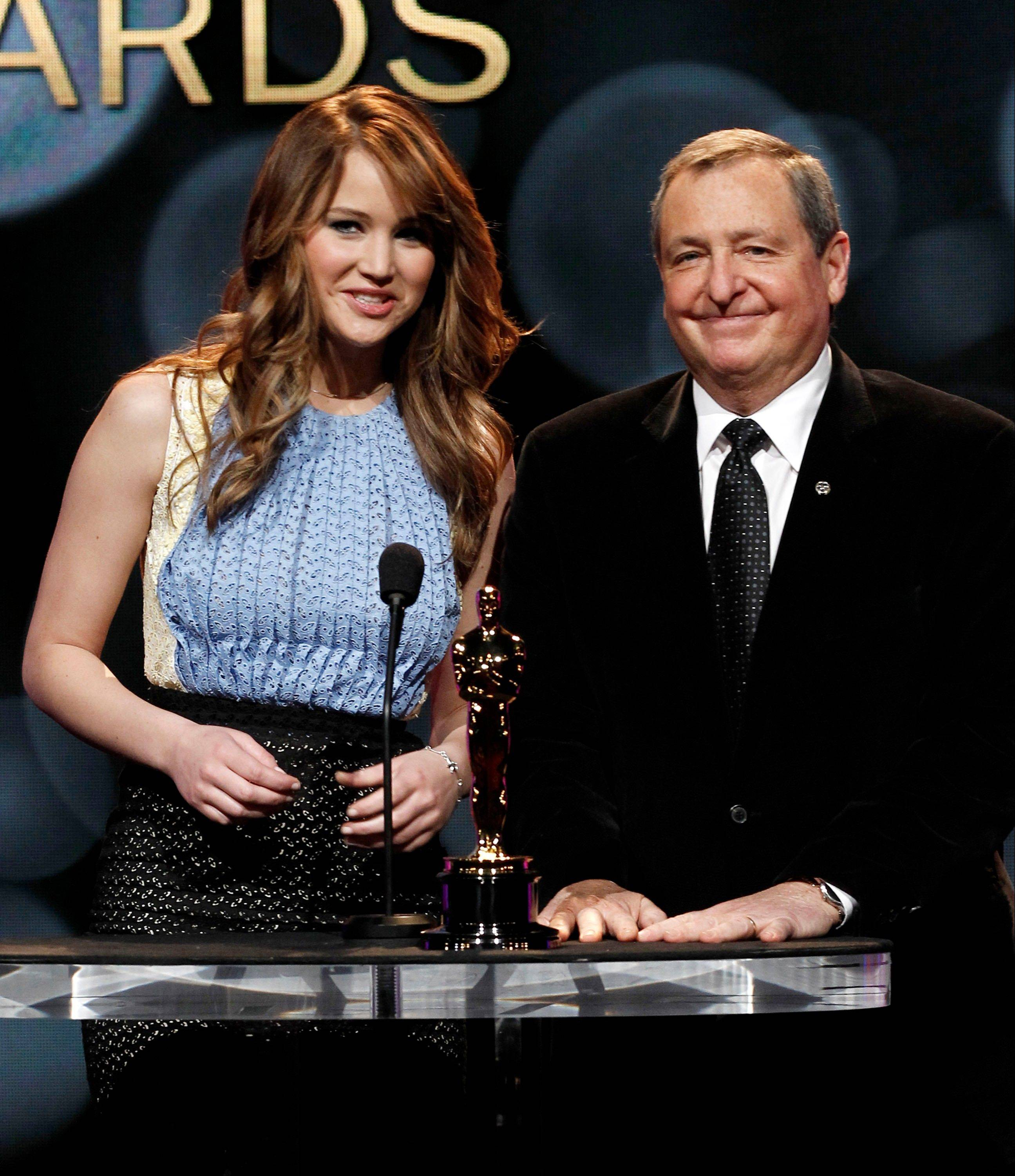 Actress Jennifer Lawrence, left, and the Academy of Motion Picture Arts and Sciences President Tom Sherak start the nominations for the 84th Annual Academy Awards, in Beverly Hills, Calif.