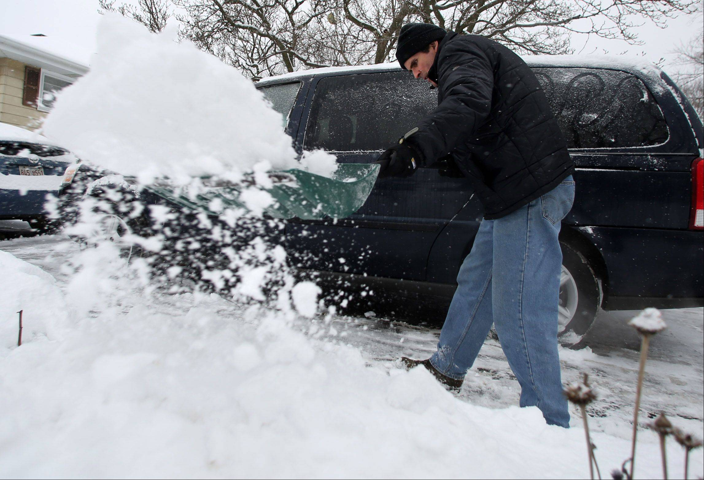 Sean West shovels show off his driveway on Saturday in Mundelein.
