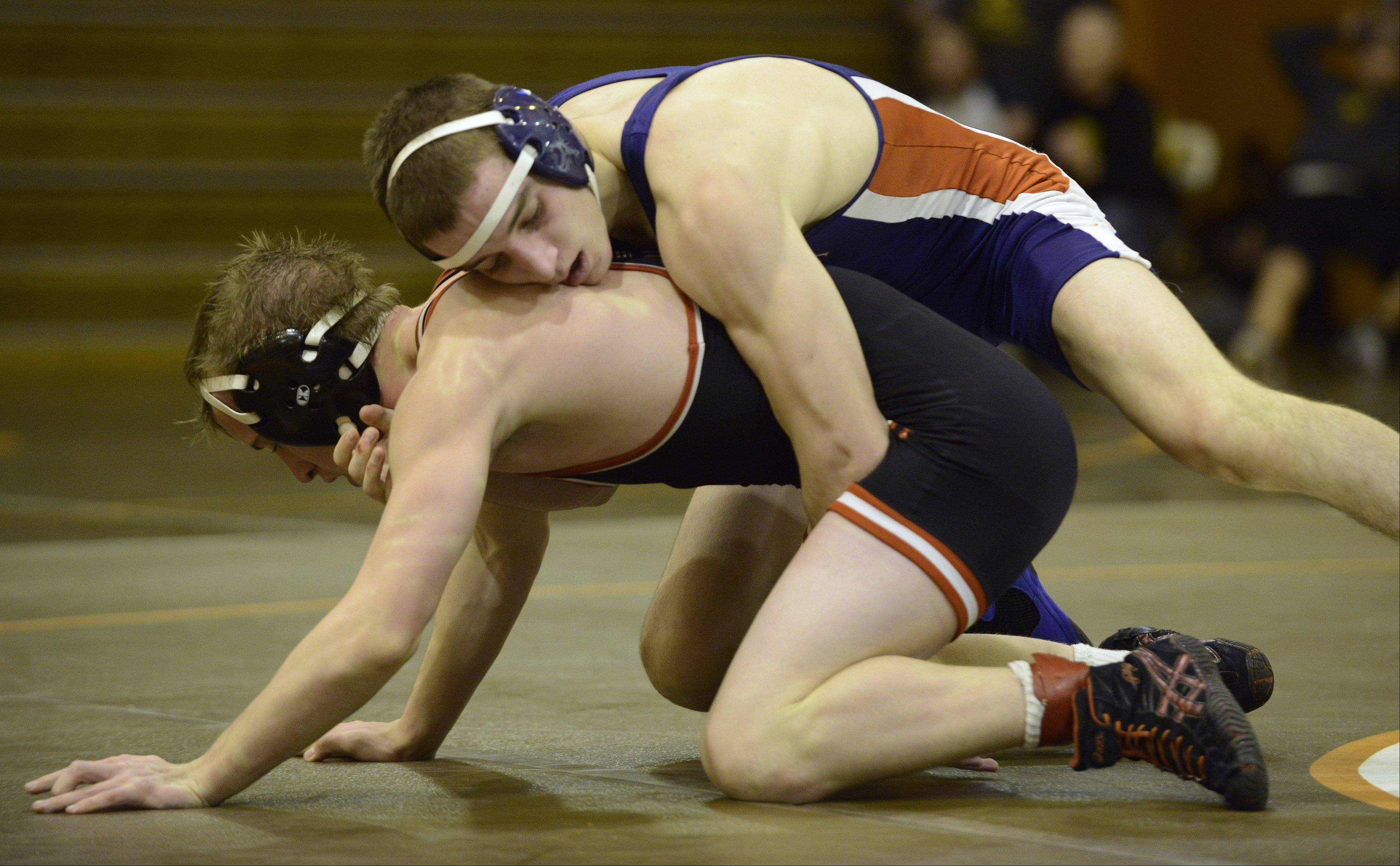 Conant's Bobby Alexander, top, wrestles Barrington's Matt Conrad in the 132-pound finals during the Mid-Suburban League wrestling meet at Hersey on Saturday.