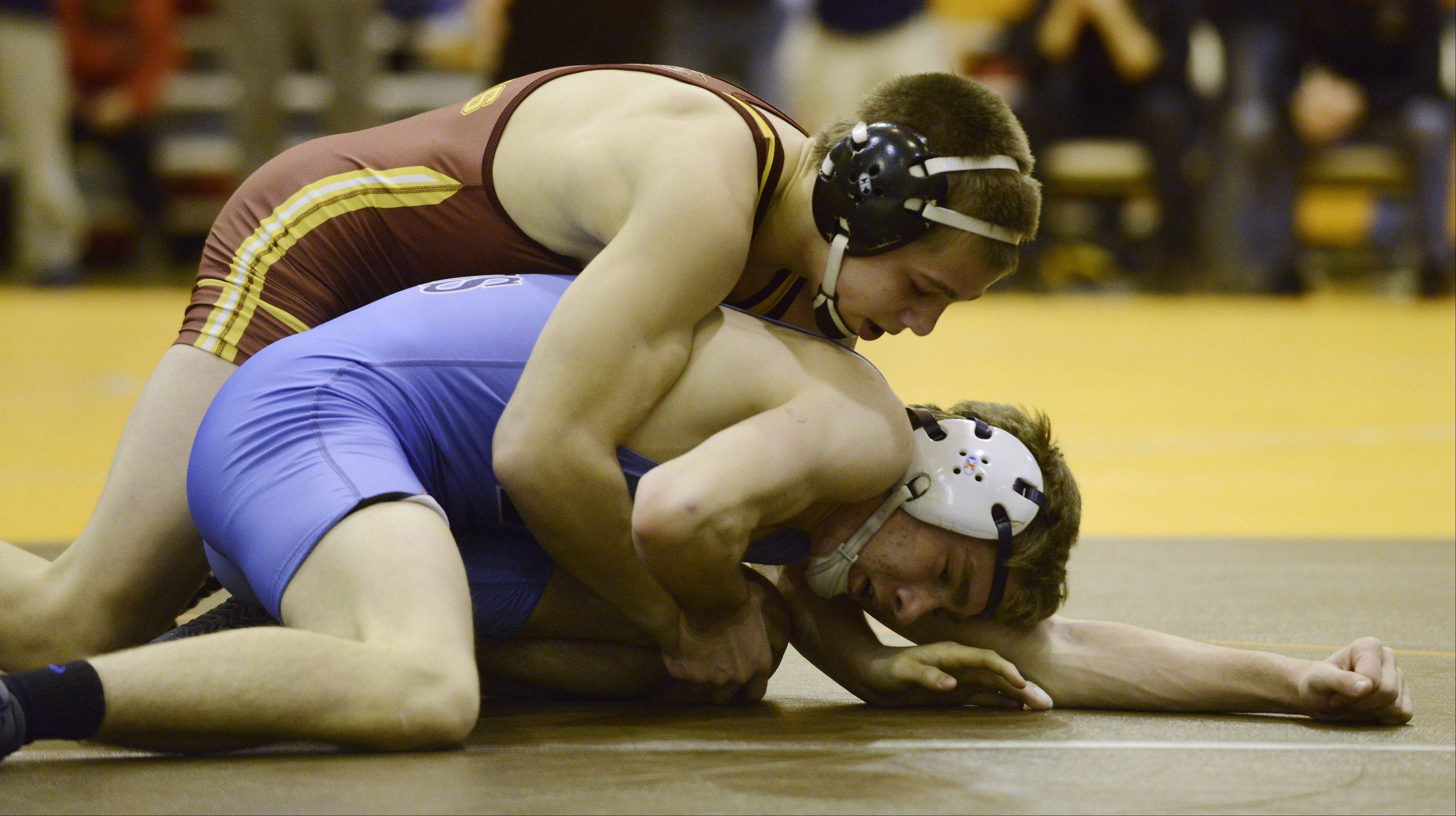 Schaumburg's Logan Gruszka, top, wrestles Prospect's Sam Lobono in the 138-pound finals during the Mid-Suburban League meet at Hersey on Saturday.
