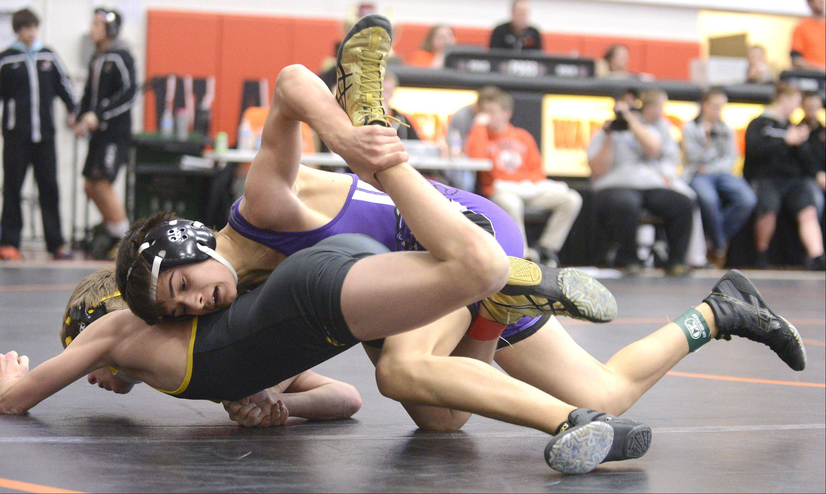Hampshire's Kyle Szlenk takes the 106-pound match championship final over Jacobs' Beau Harrier at the Fox Valley Conference meet in McHenry on Saturday.