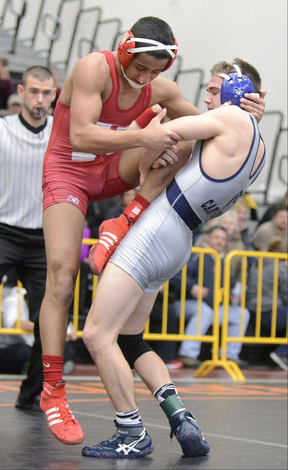 Cary-Grove's Logan Hanselmann takes down Huntley's Ricky Vigil for the win in the 126-pound championship at the Fox Valley Conference meet in McHenry on Saturday.