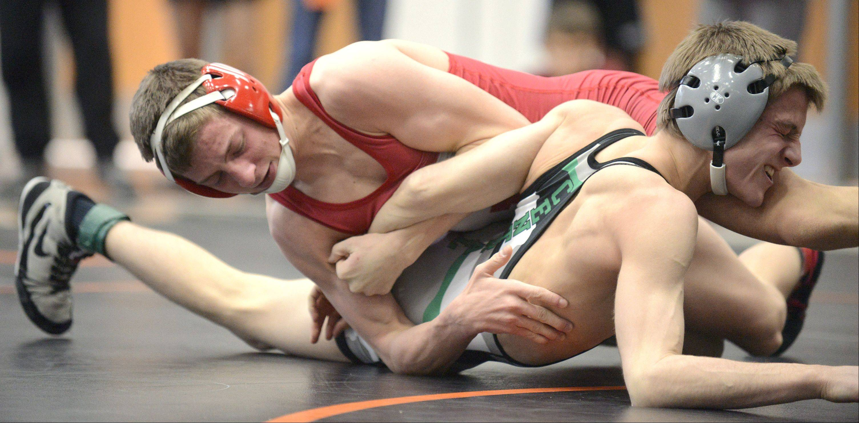 Huntley's Nick Meyer pins Grayslake Central's Kurt Radke in the 113-pound match for third place in the finals at the Fox Valley Conference meet in McHenry on Saturday.