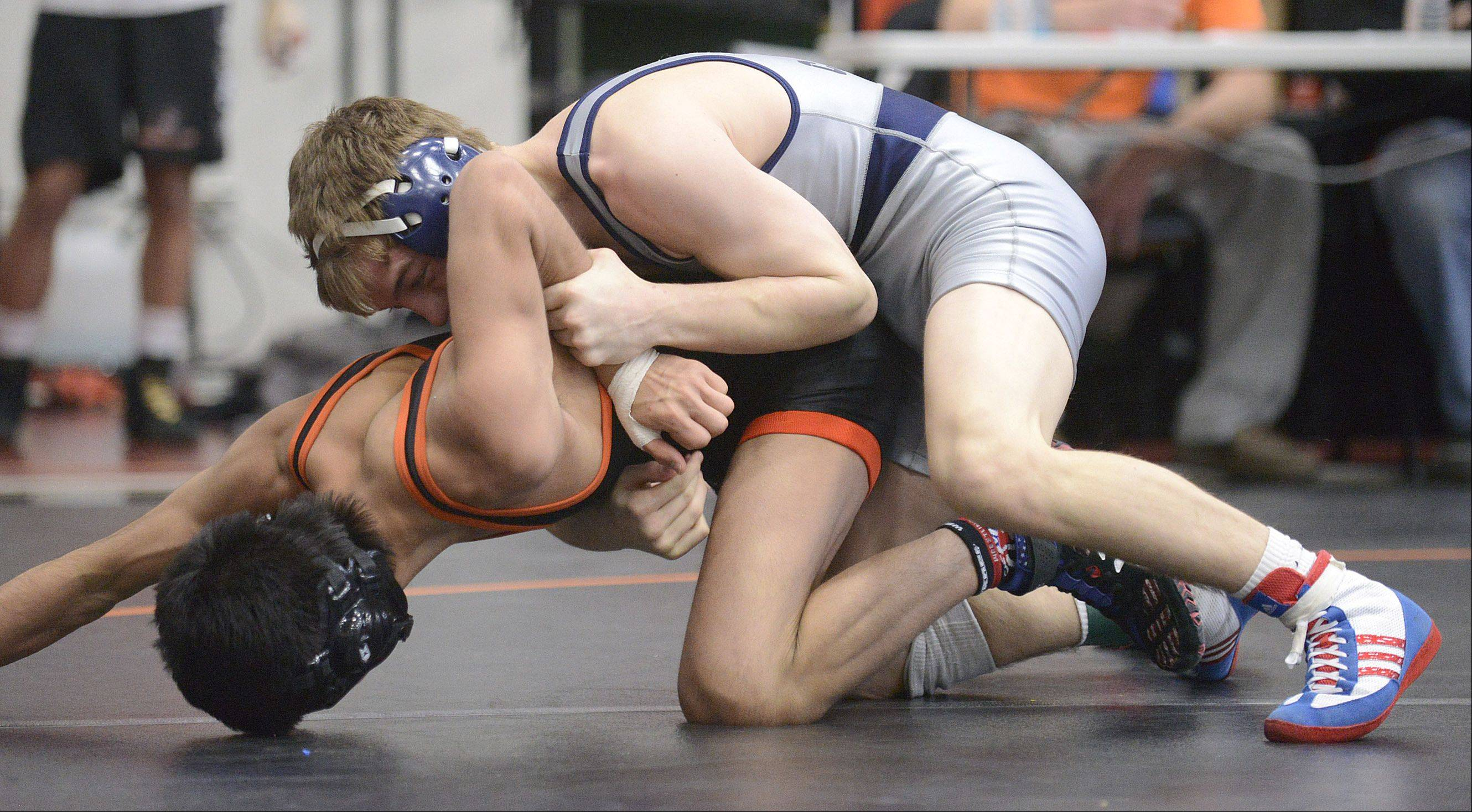 Cary-Grove's Michael Cullen takes the 120-pound championship match over Crystal Lake Central's Lenny Peterson at the Fox Valley Conference meet in McHenry on Saturday.