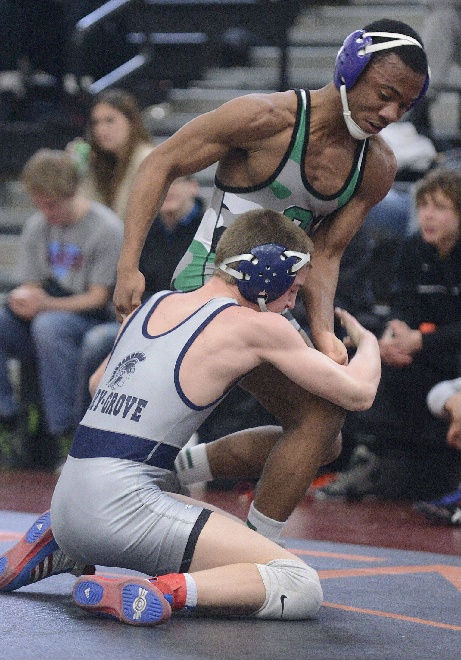 Cary-Grove's John Cullen takes down Grayslake Central's Larry Augistine in the third place 132-pound final match at the Fox Valley Conference meet in McHenry on Saturday.