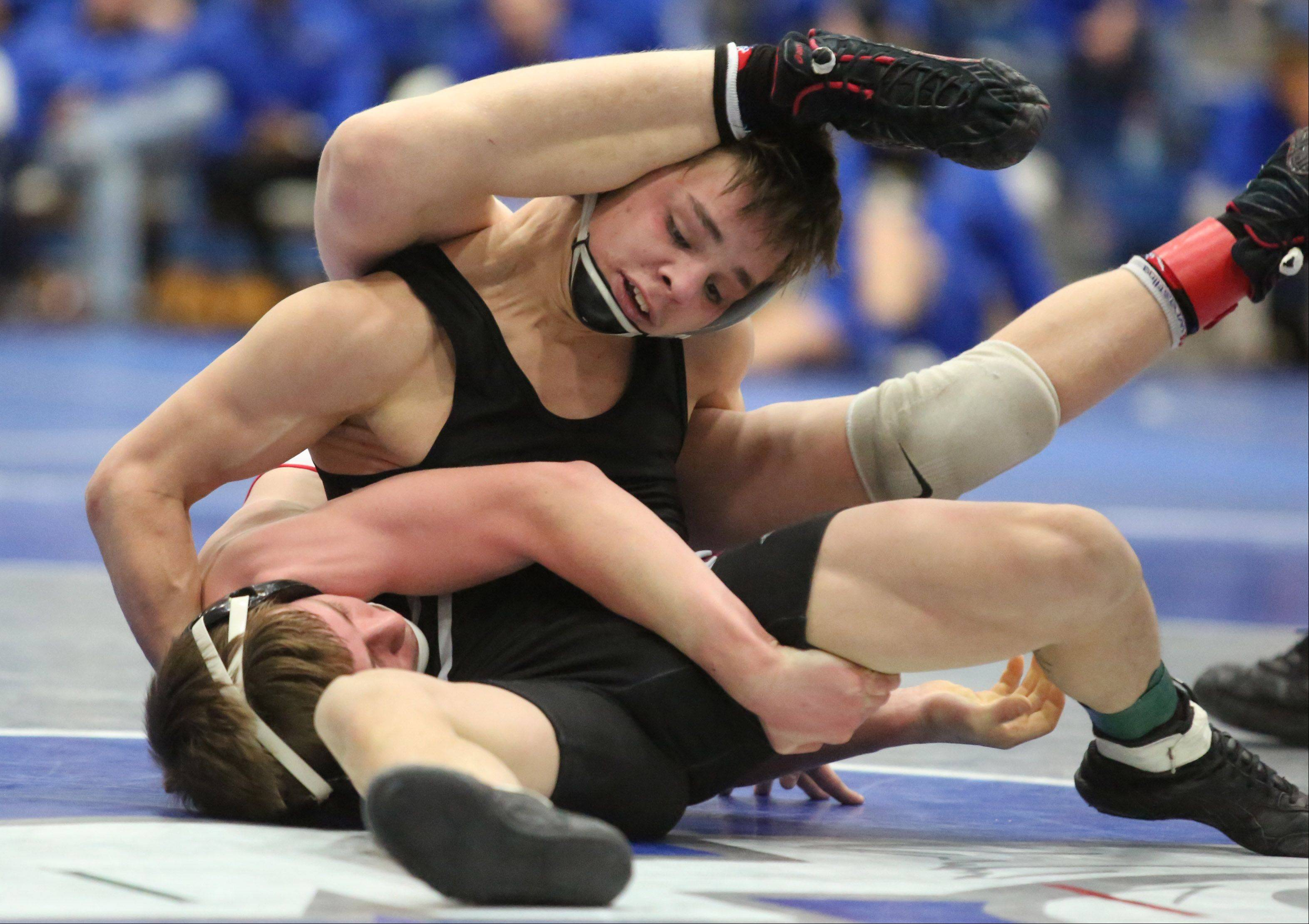 Grant's Christian Kanzler, left, wins the 106-pound final against Antioch's Briley Schultz in the North Suburban Conference meet Saturday at Vernon Hills.