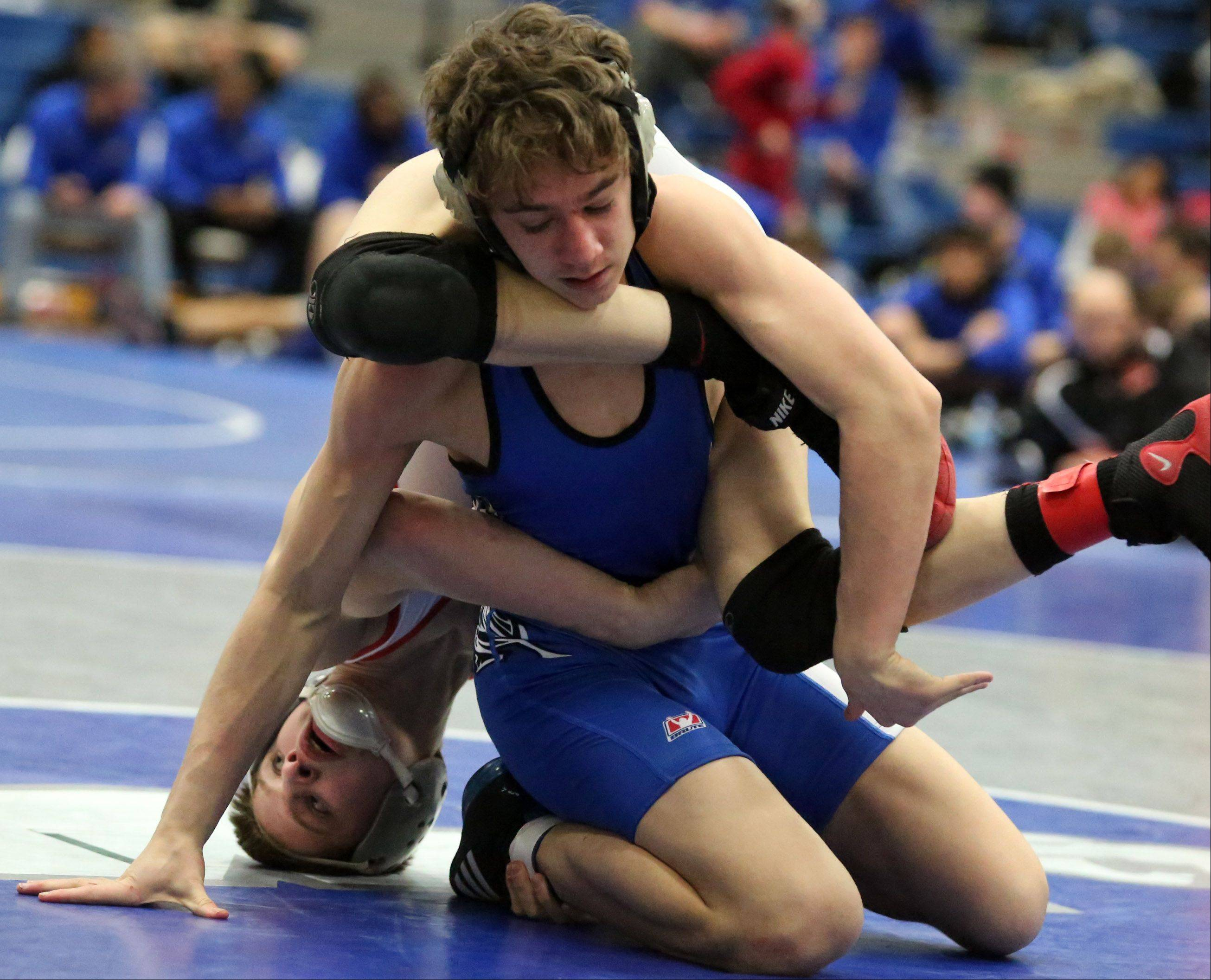 Grant's Gage Datlovsky gets a leg lock on Vernon Hills' Jordan Reich, with Gage winning the 120-pound final in North Suburban Conference meet Saturday at Vernon Hills.