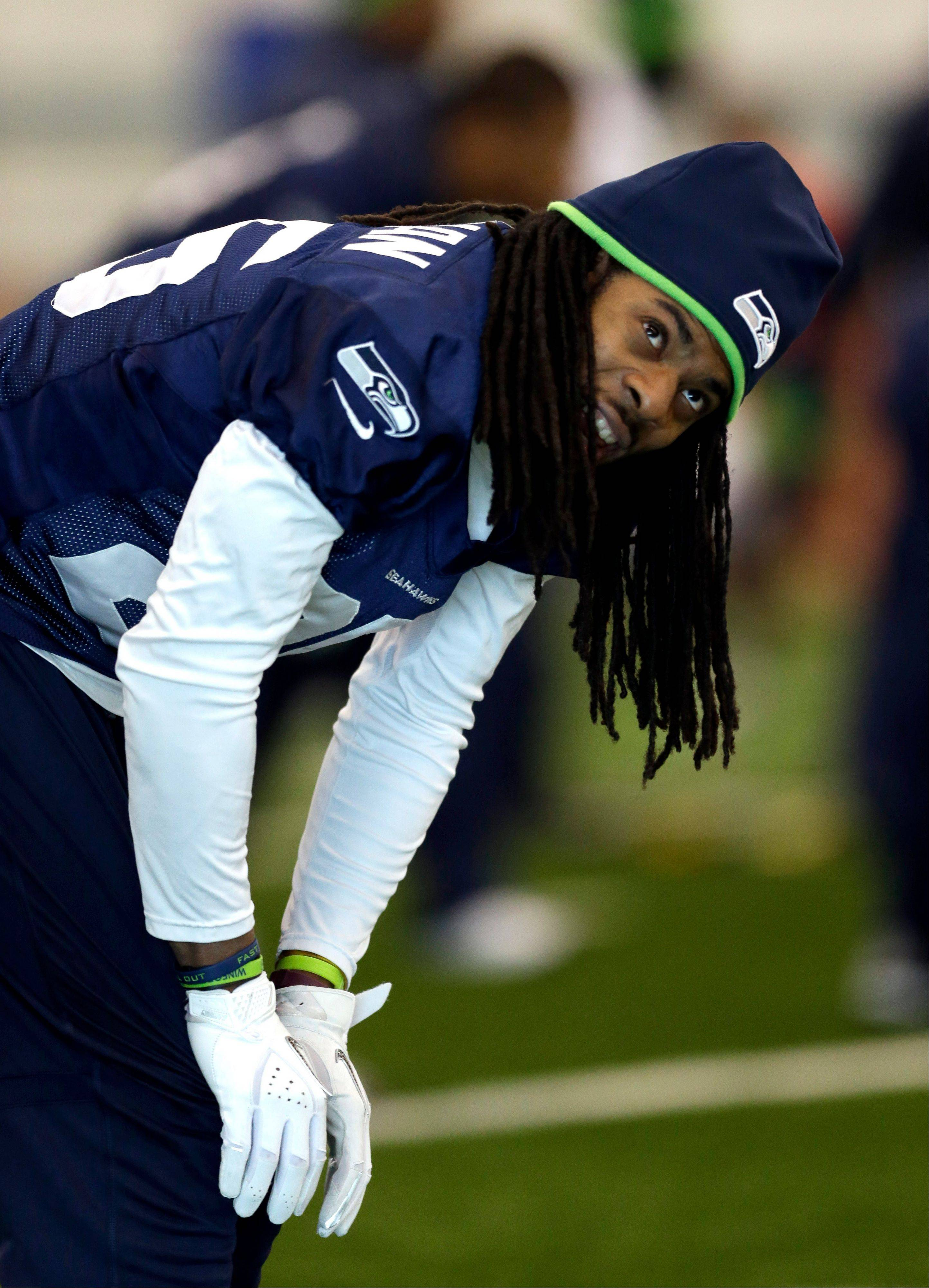 Seattle Seahawks cornerback Richard Sherman warms up during NFL football practice Friday, Jan. 31, 2014, in East Rutherford, N.J. The Seahawks and the Denver Broncos are scheduled to play in the Super Bowl XLVIII football game Sunday, Feb. 2, 2014.
