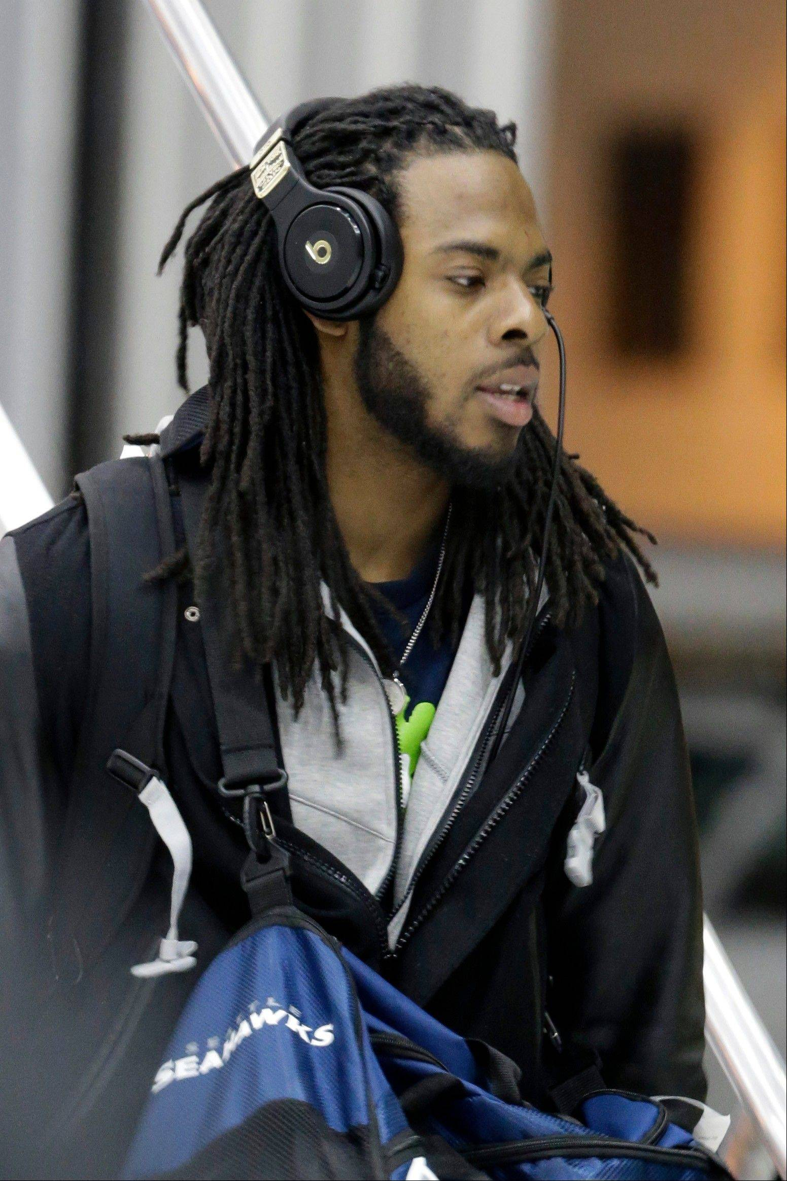 Seattle Seahawks' Richard Sherman arrives at Newark Liberty International Airport for the NFL Super Bowl XLVIII football game, Sunday, Jan. 26, 2014, in Newark, N.J.