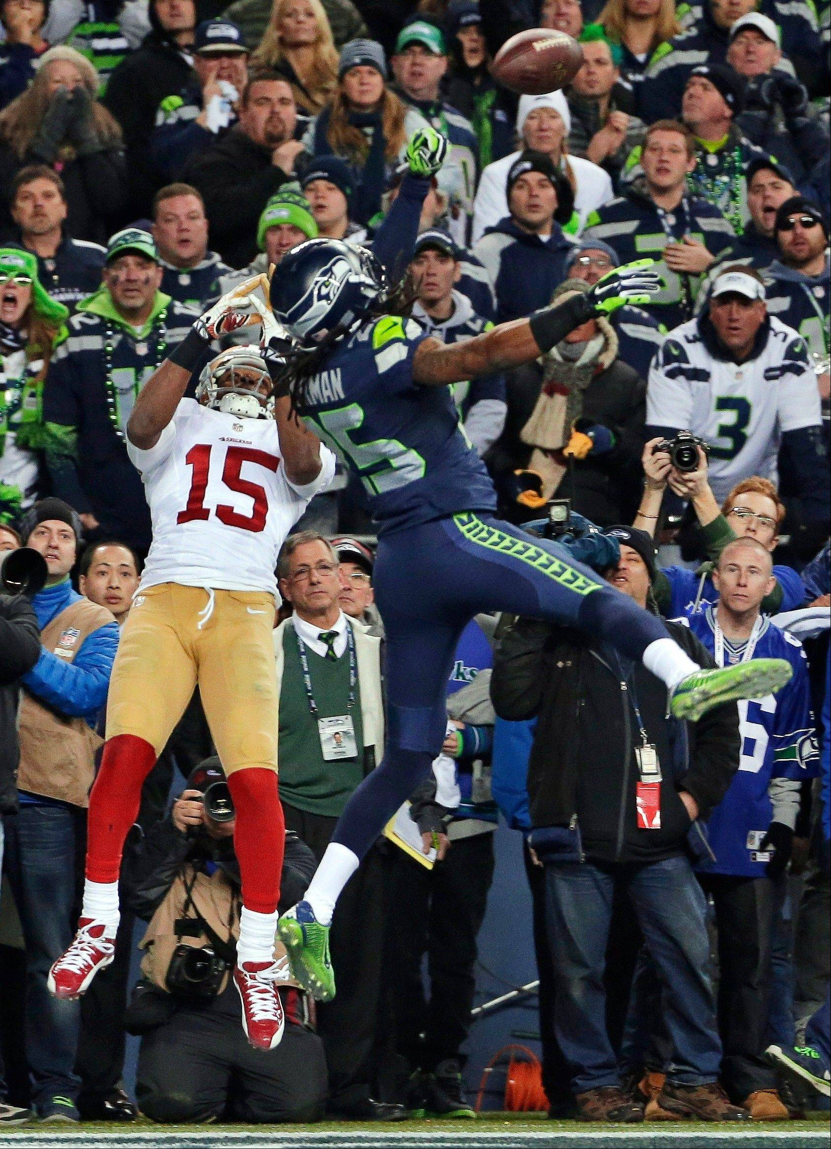 Richard Sherman (25) tips a pass in the end zone intended for San Francisco 49ers' Michael Crabtree (15) in the final minute of the second half of the NFC championship NFL football game in Seattle. Seattle's Malcolm Smith intercepted the tipped pass. Sherman was fined $7,875 for unsportsmanlike conduct/taunting after he made a choking gesture after the play toward the San Francisco bench that he said was directed at quarterback Colin Kaepernick.