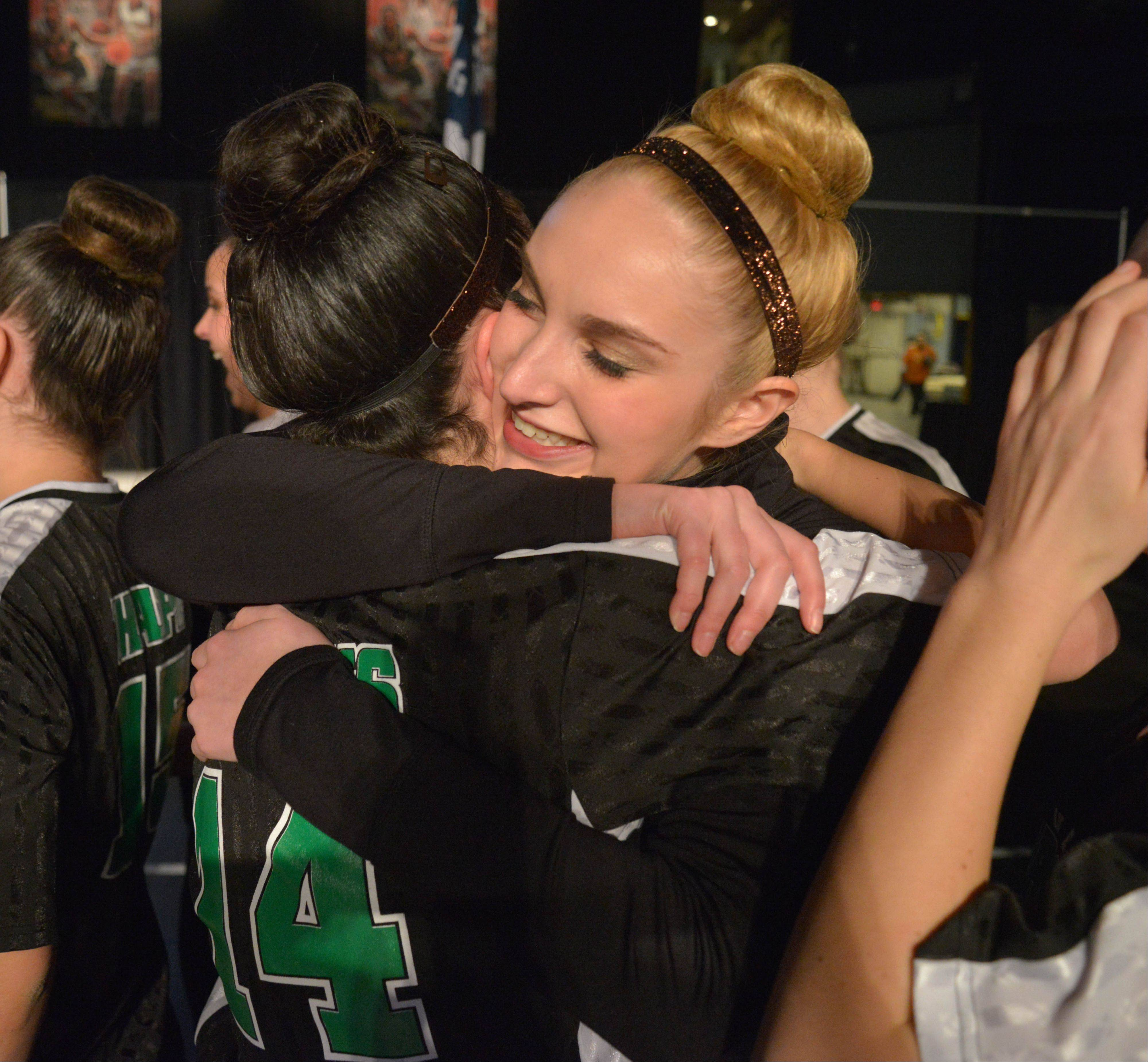 Alison Marks, left, hugs Jenna Puritz both of Stevenson High School after they won 3rd in the 3A IHSA Dance State Final at U.S. Cellular Coliseum in Bloomington Saturday. 90 teams vied for state champion at this event.