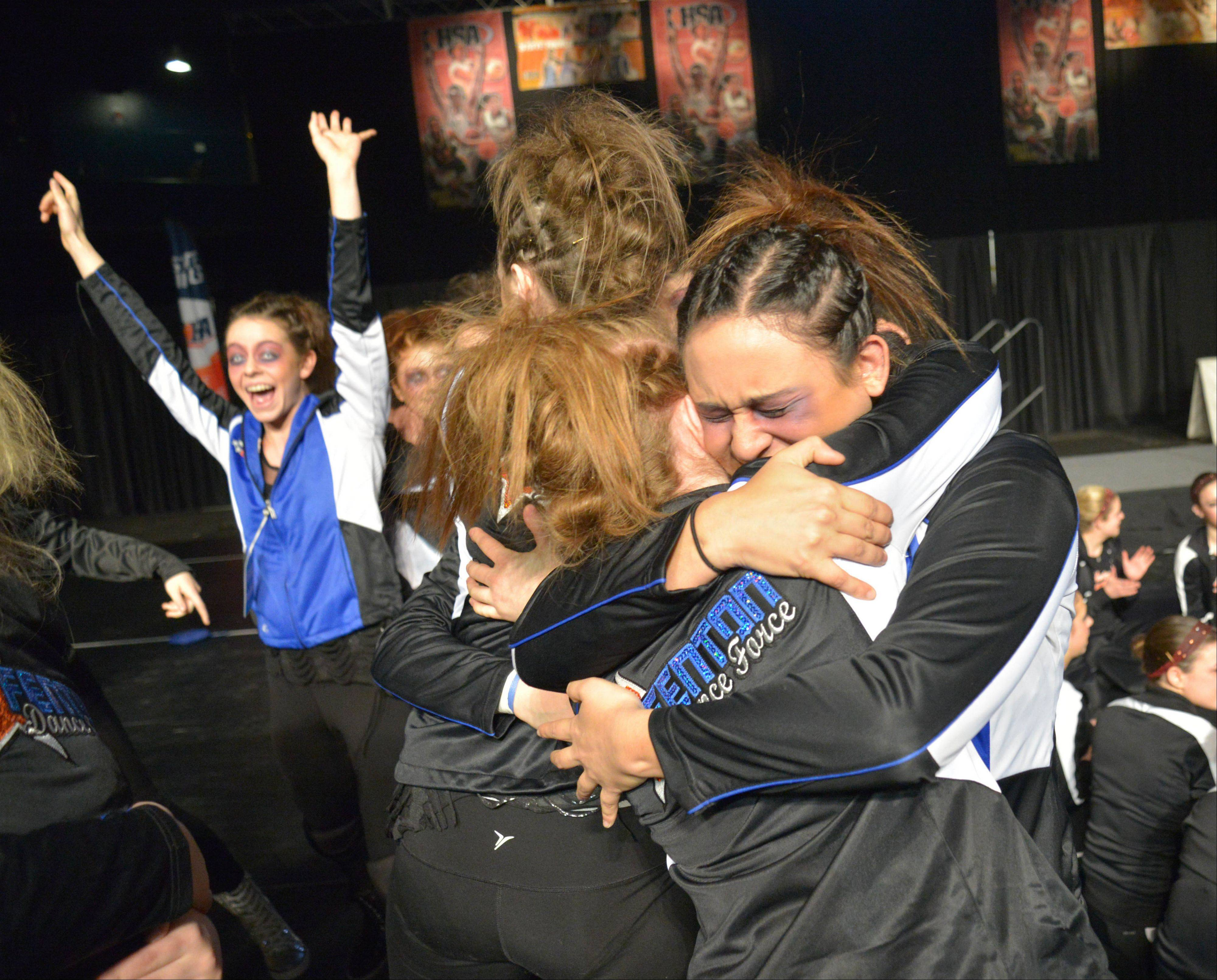 Emanuela Alexe, right, hugs Brittany Irizarry of Fenton High School after they won 3rd in the 2A IHSA Dance State Final at U.S. Cellular Coliseum in Bloomington Saturday. 90 teams vied for state champion at this event.