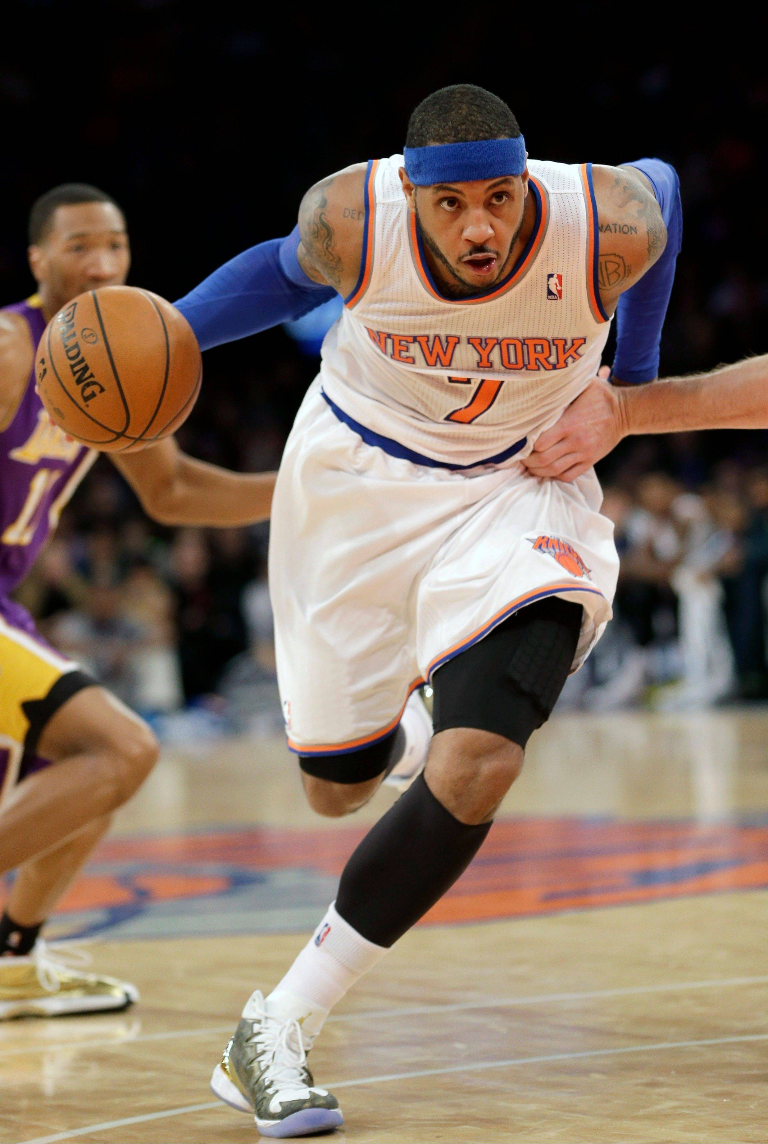 New York Knicks' Carmelo Anthony charges the basket during the second half of an NBA basketball game against the Los Angeles Lakers at Madison Square Garden, Sunday, Jan. 26, 2014, in New York. The Knicks won 110-103.
