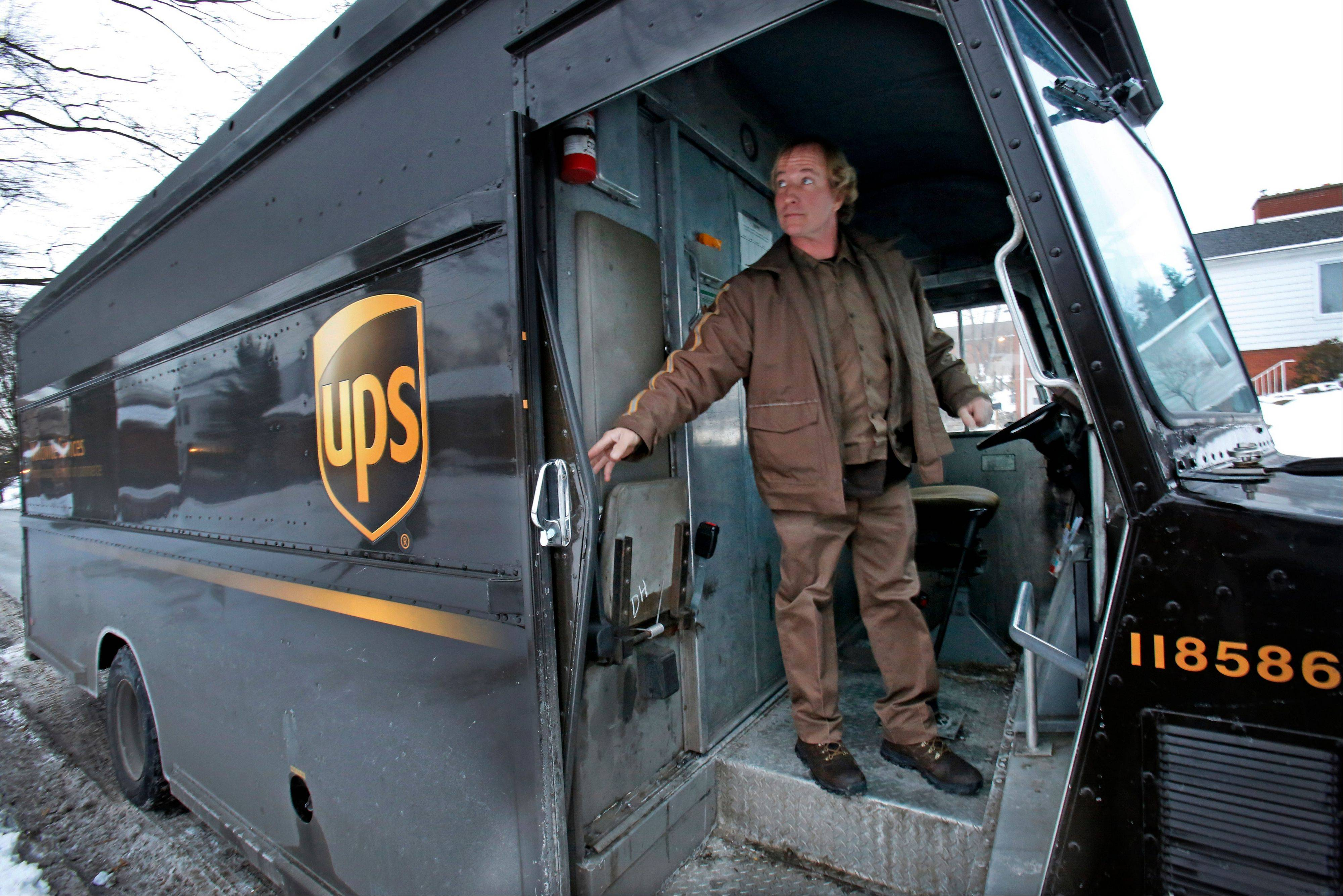 United Parcel Service Inc. said it will spend more than $100 million to improve peak-period service after a late surge in online Christmas shopping caused missed deliveries that boosted costs.