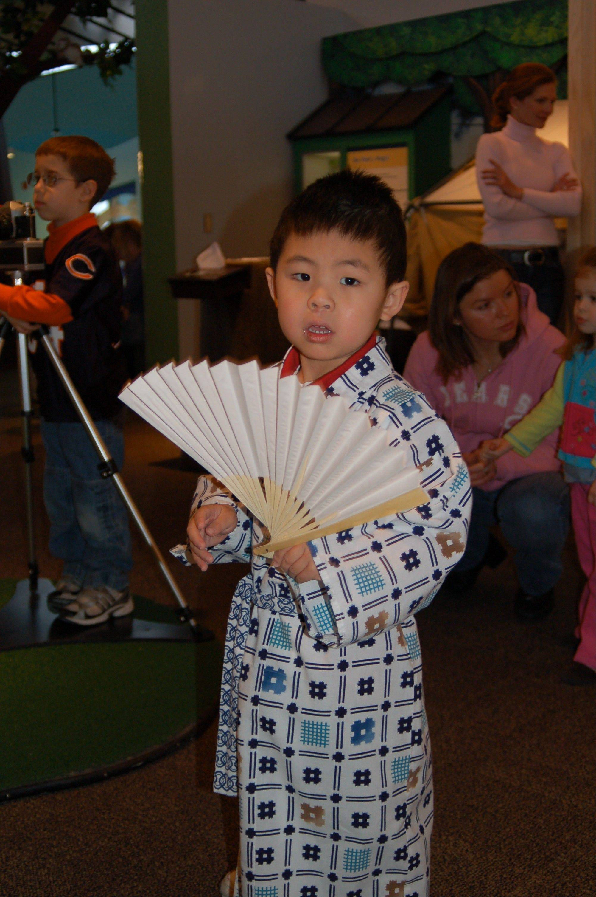 "Children can try on traditional clothing at the Kohl Children's Museums's exhibit ""Japan and Nature: Spirits of the Season."""