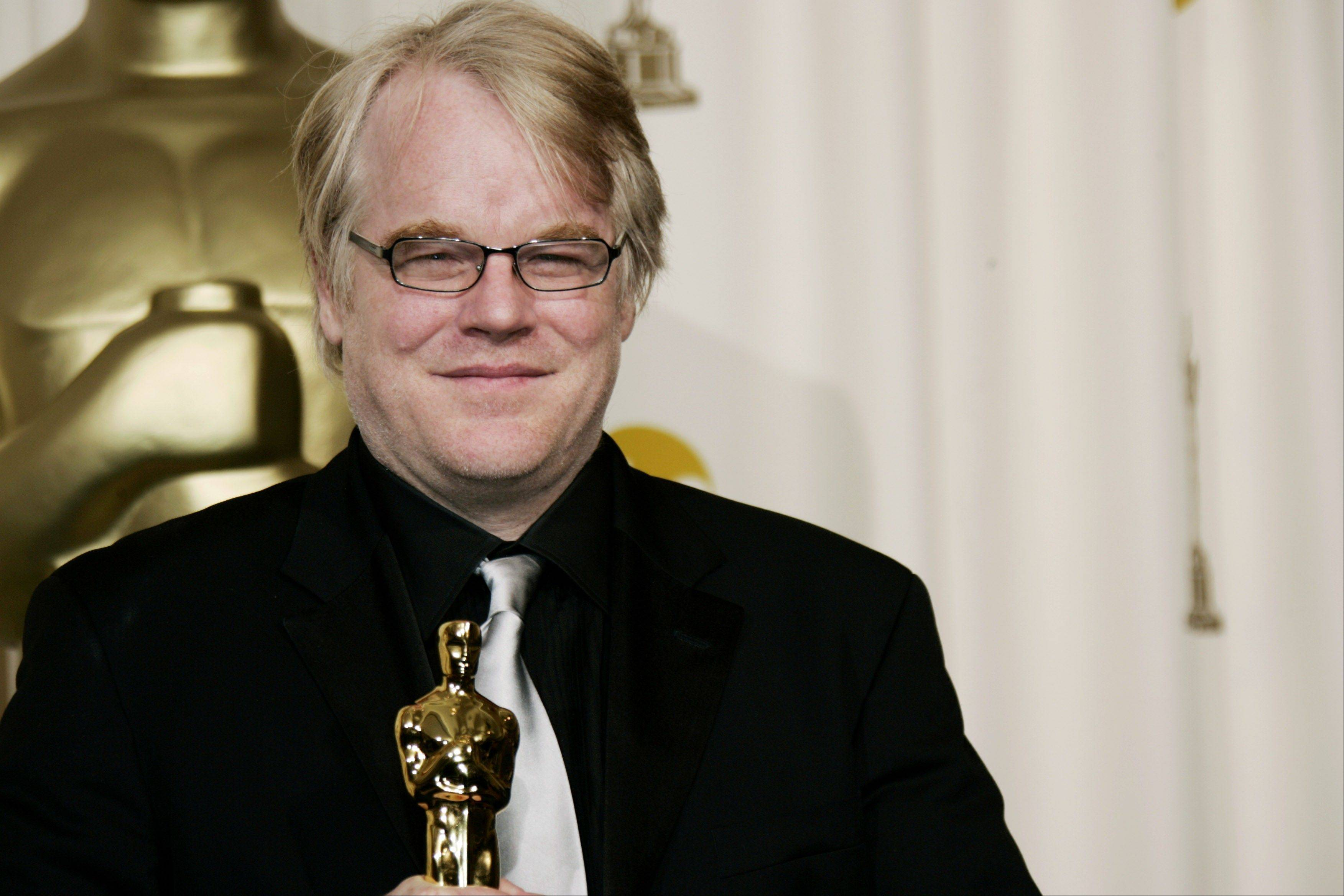 "In a Sunday, March 5, 2006, file photo, actor Philip Seymour Hoffman poses with the Oscar he won for best actor for his work in ""Capote"" at the 78th Academy Awards in Los Angeles. Hoffman died Sunday, Feb. 2, in his New York City apartment."