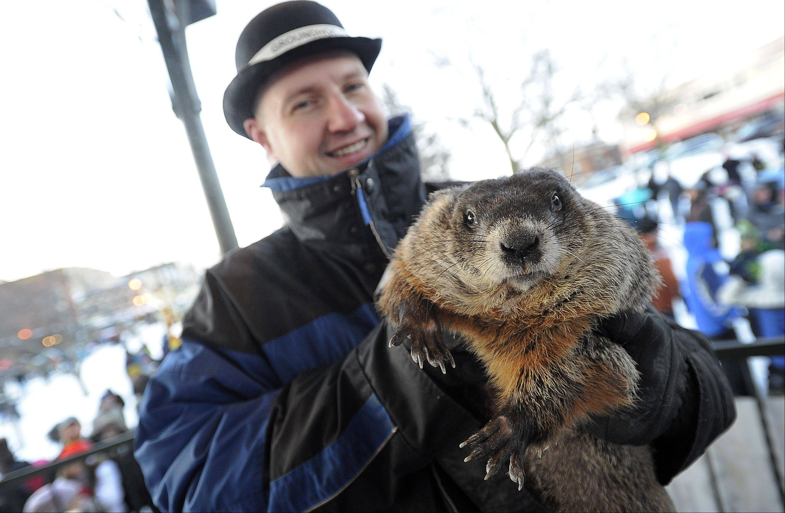 Woodstock Willie, being held up for the crowd on the Woodstock Square by animal wrangler Mark Szafran, gave a disappointing forecast Sunday morning. Willie saw his shadow, meaning six more weeks of winter.