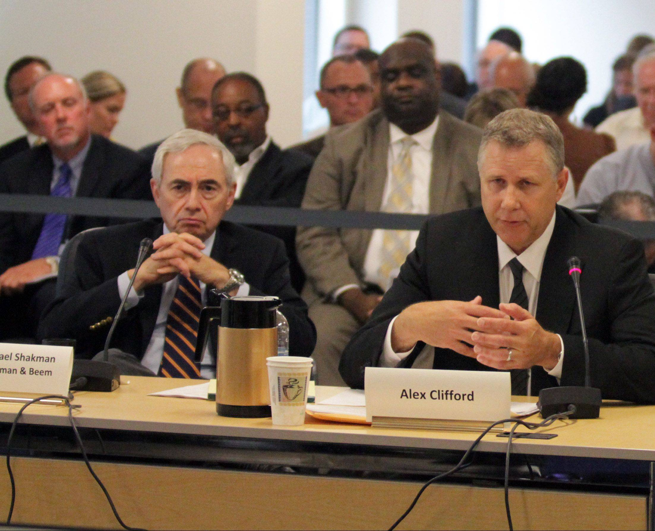 Former Metra CEO Alex Clifford, right, testifies to the RTA last summer during a hearing. Clifford�s severence deal could end up costing Metra $871,000, an RTA audit forecasts.