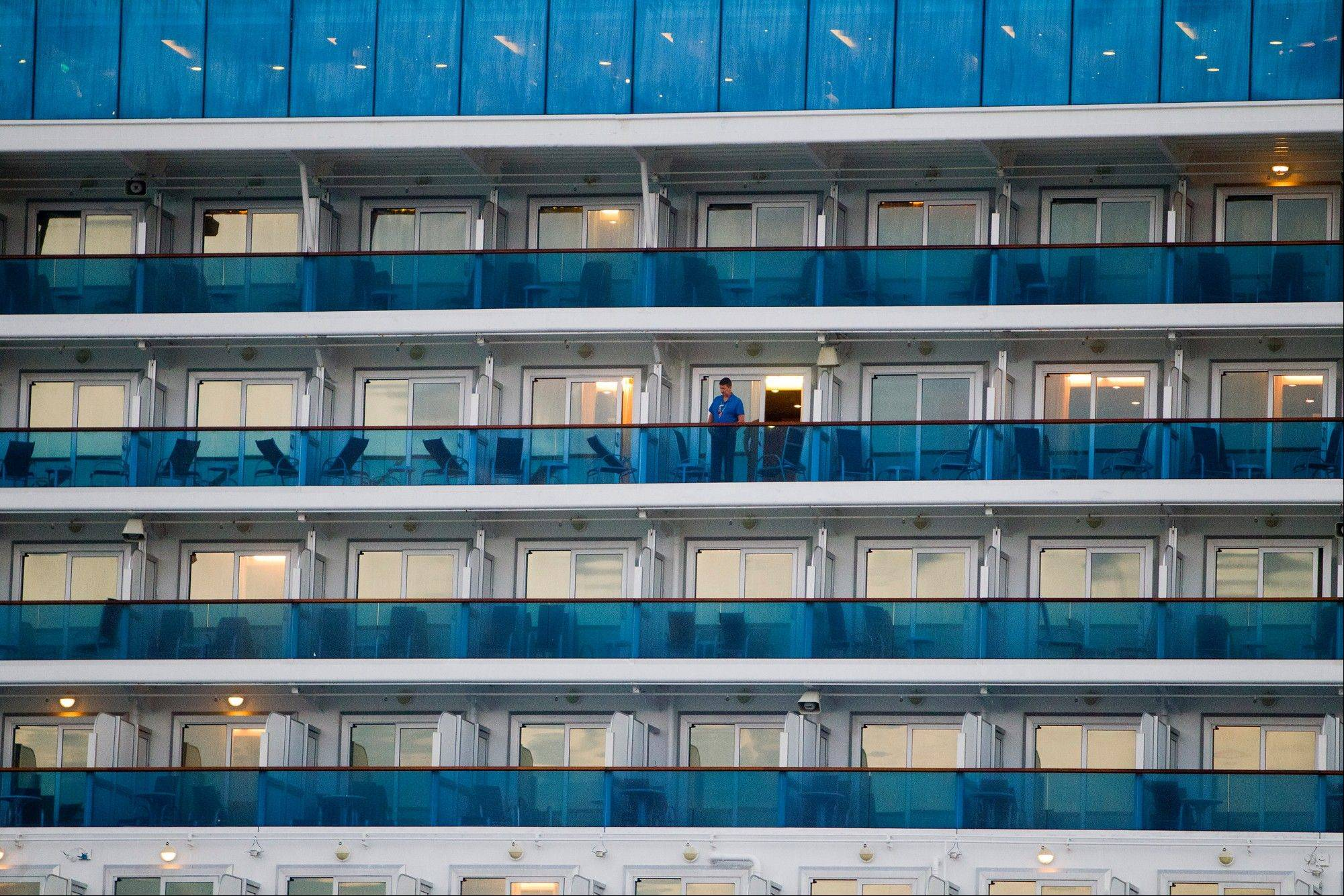 Passengers wait to get off the Caribbean Princess cruise ship Friday, after it returned to a Houston-area port.