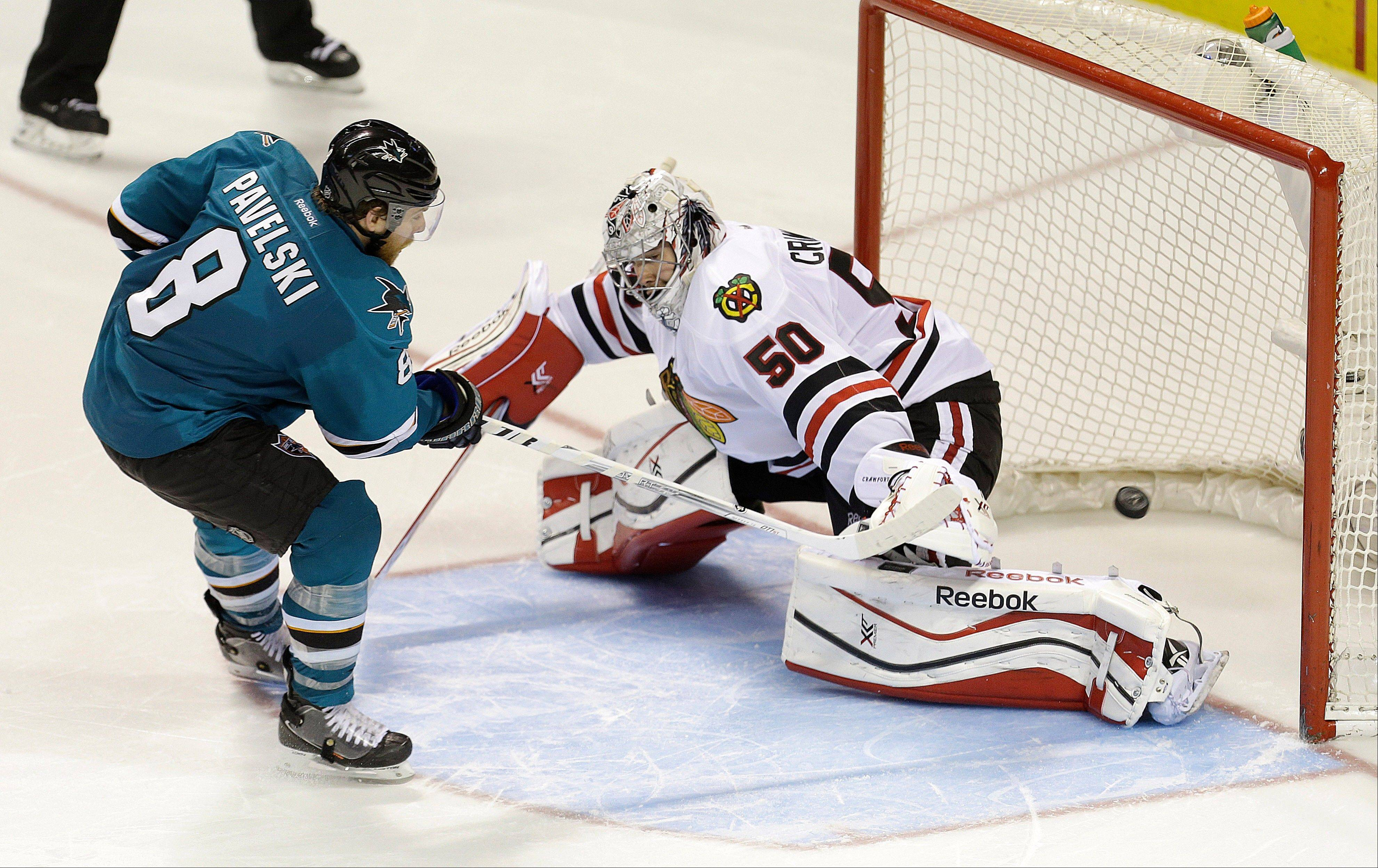 Associated Press The Sharks� Joe Pavelski scores a goal in a shootout, beating Blackhawks goalie Corey Crawford on Saturday night in San Jose, Calif.