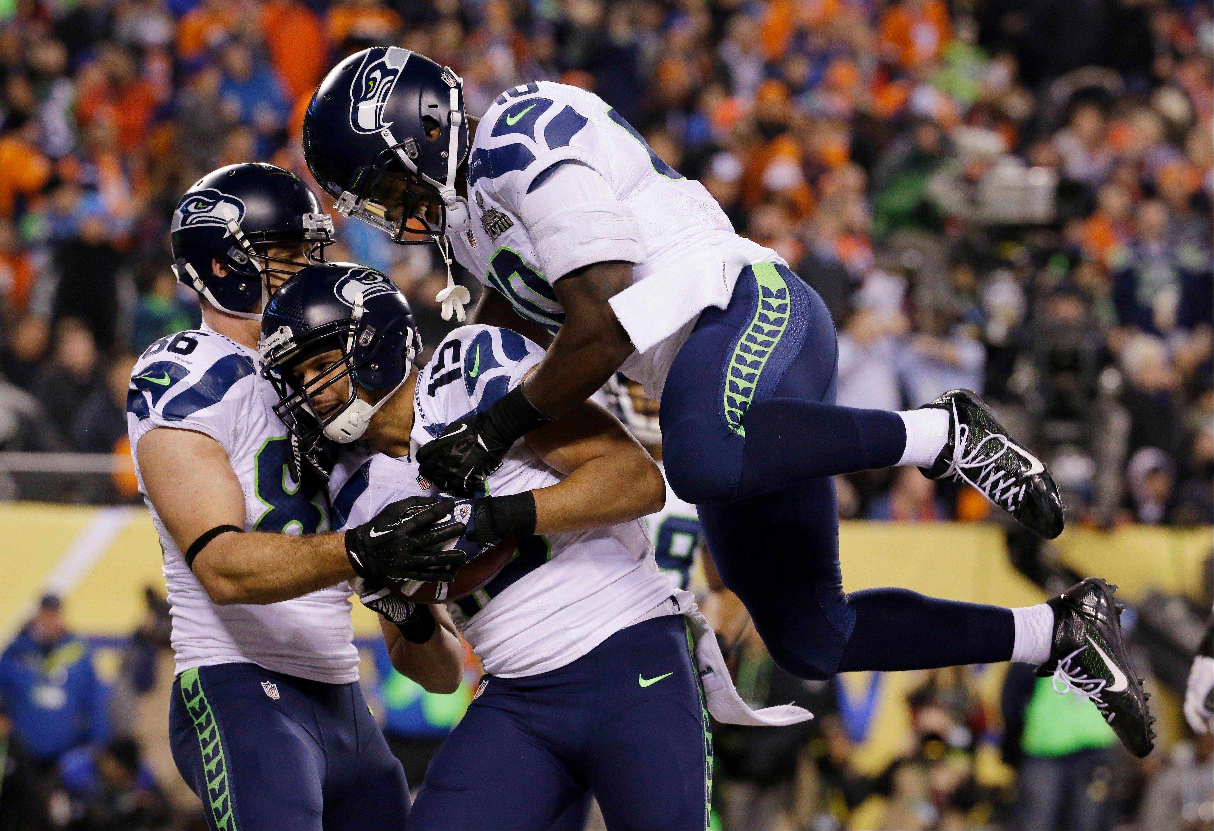 Seattle Seahawks' Jermaine Kearse, center, celebrates with teammate Derrick Coleman, right, after catching a 23-yard touchdown pass during the second half of the NFL Super Bowl XLVIII football game against the Denver Broncos Sunday, Feb. 2, 2014, in East Rutherford, N.J. The Seahawks won 43-8.
