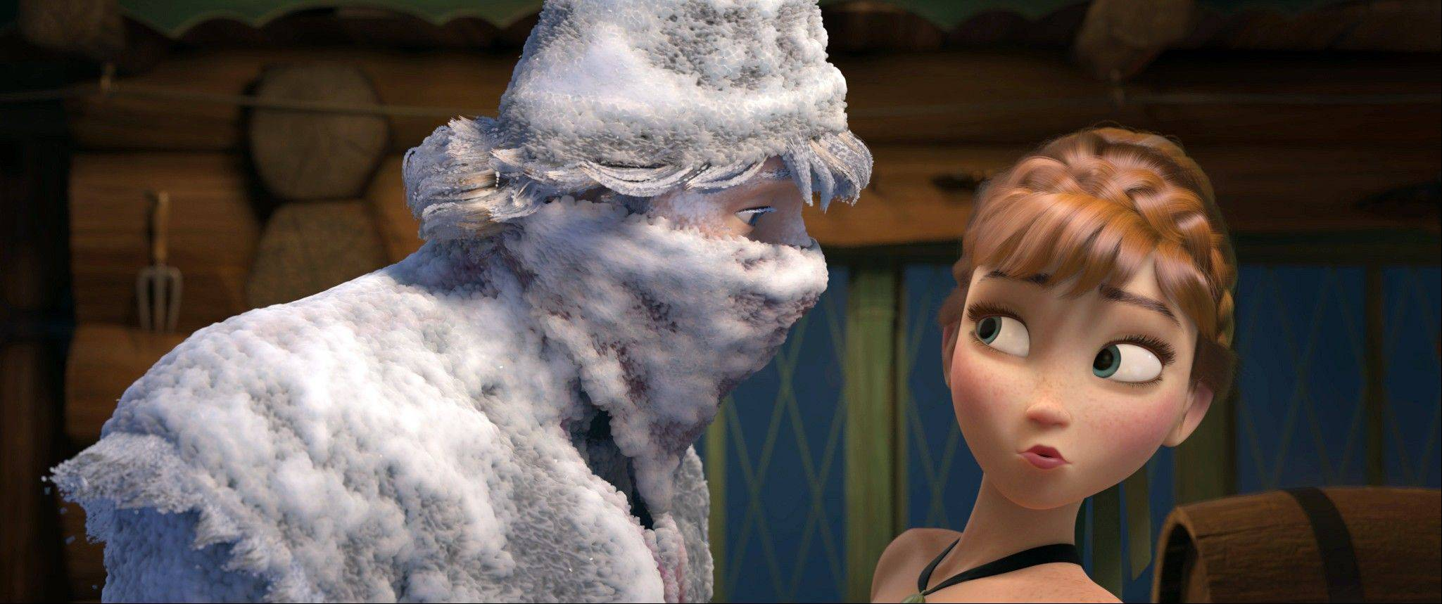 "This image released by Disney shows Kristoff, voiced by Jonathan Groff, left, and Anna, voiced by Kristen Bell, in a scene from the animated feature film, ""Frozen."" The animated film, which just launched a singalong version, landed at No. 2 after 11 weeks of release."