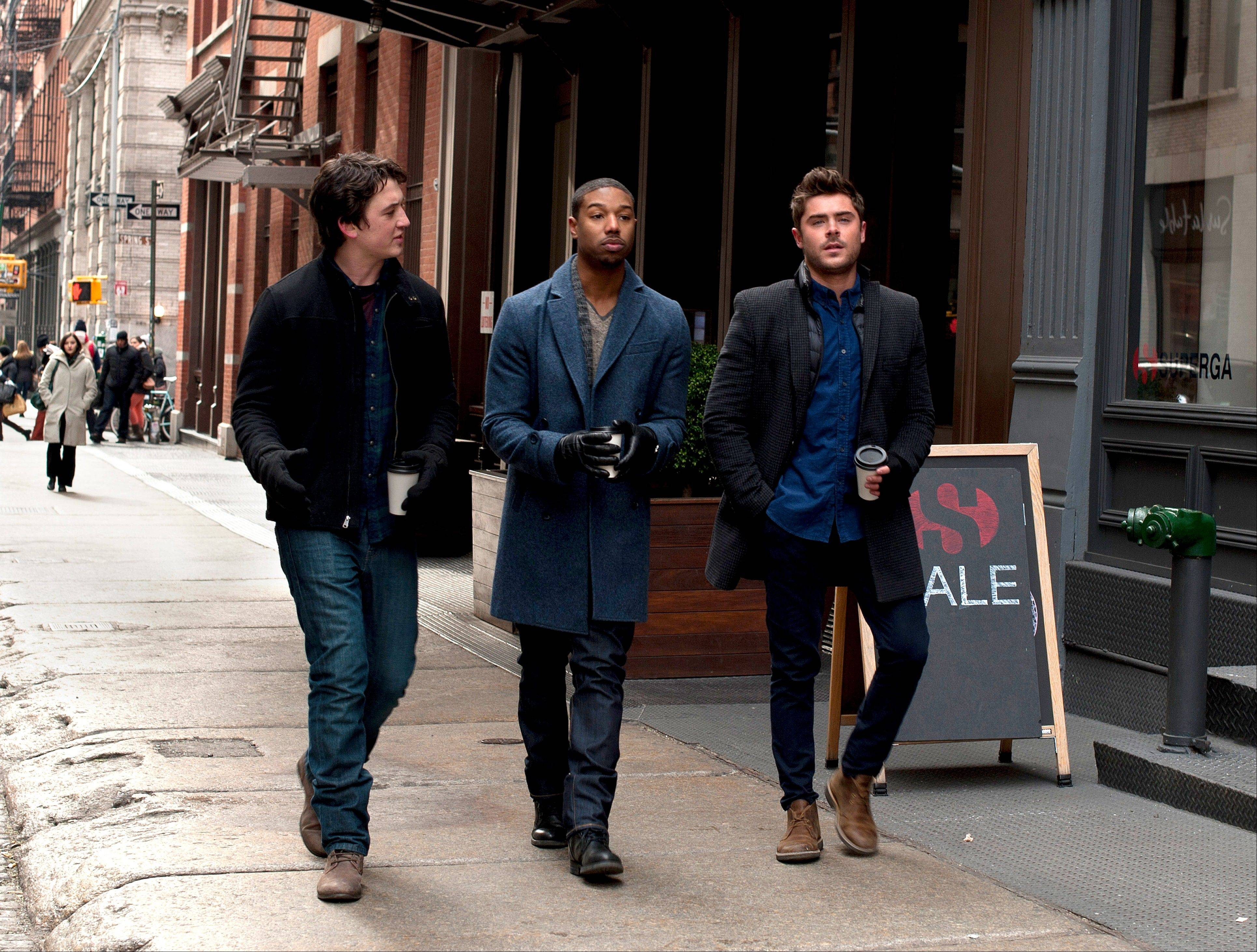 "This image released by Focus Features shows, from left, Miles Teller, Michael B. Jordan and Zac Efron in a scene from ""That Awkward Moment."" The film came in at No. 3 at the box office in its first weekend of release."