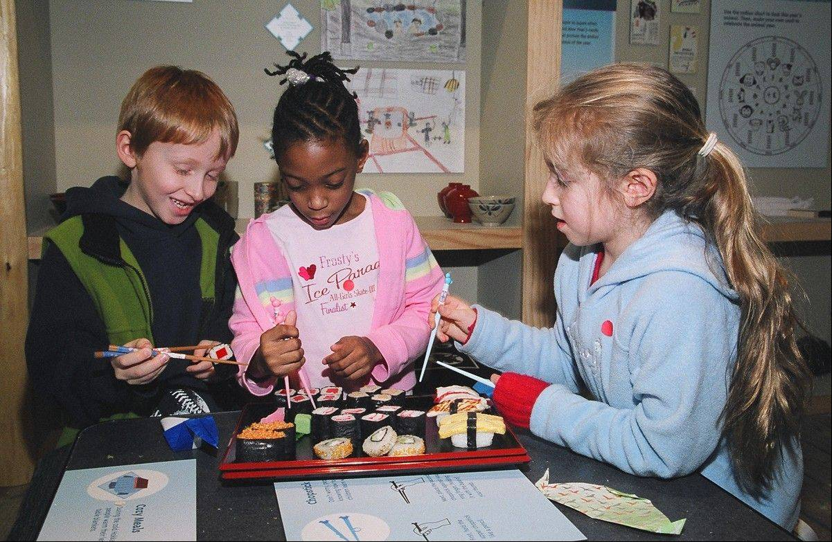 "Children practice the Japanese style of eating at ""Japan and Nature: Spirits of the Season."""