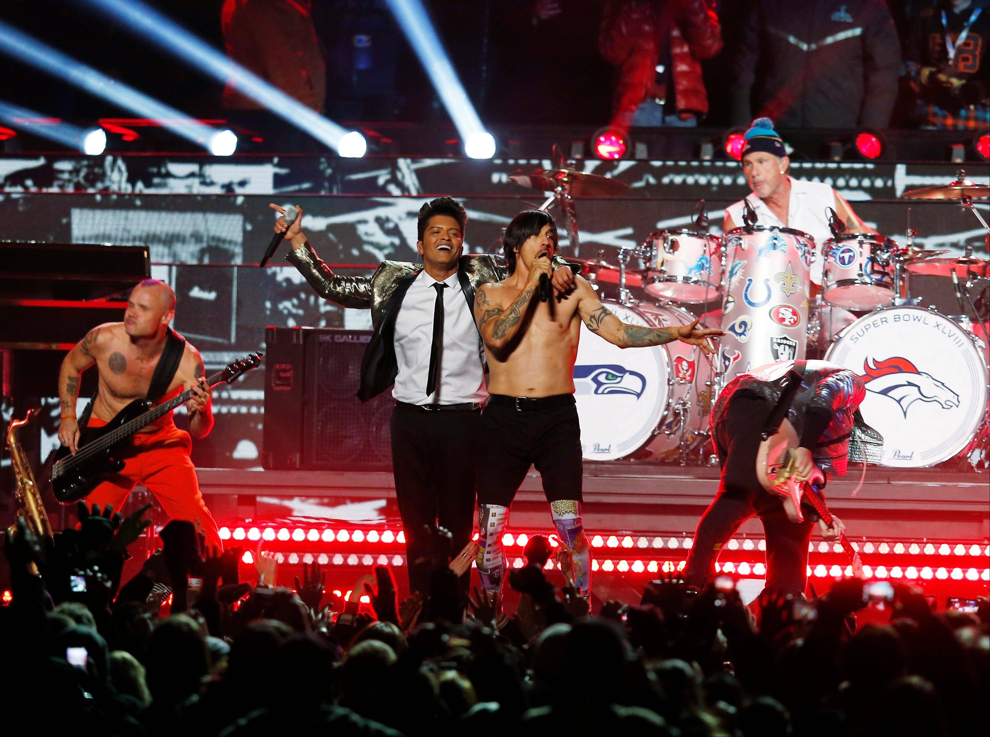 Bruno Mars, left, performs during the halftime show of the NFL Super Bowl XLVIII football game at MetLife Stadium in East Rutherford, New Jersey on Sunday, February 2.