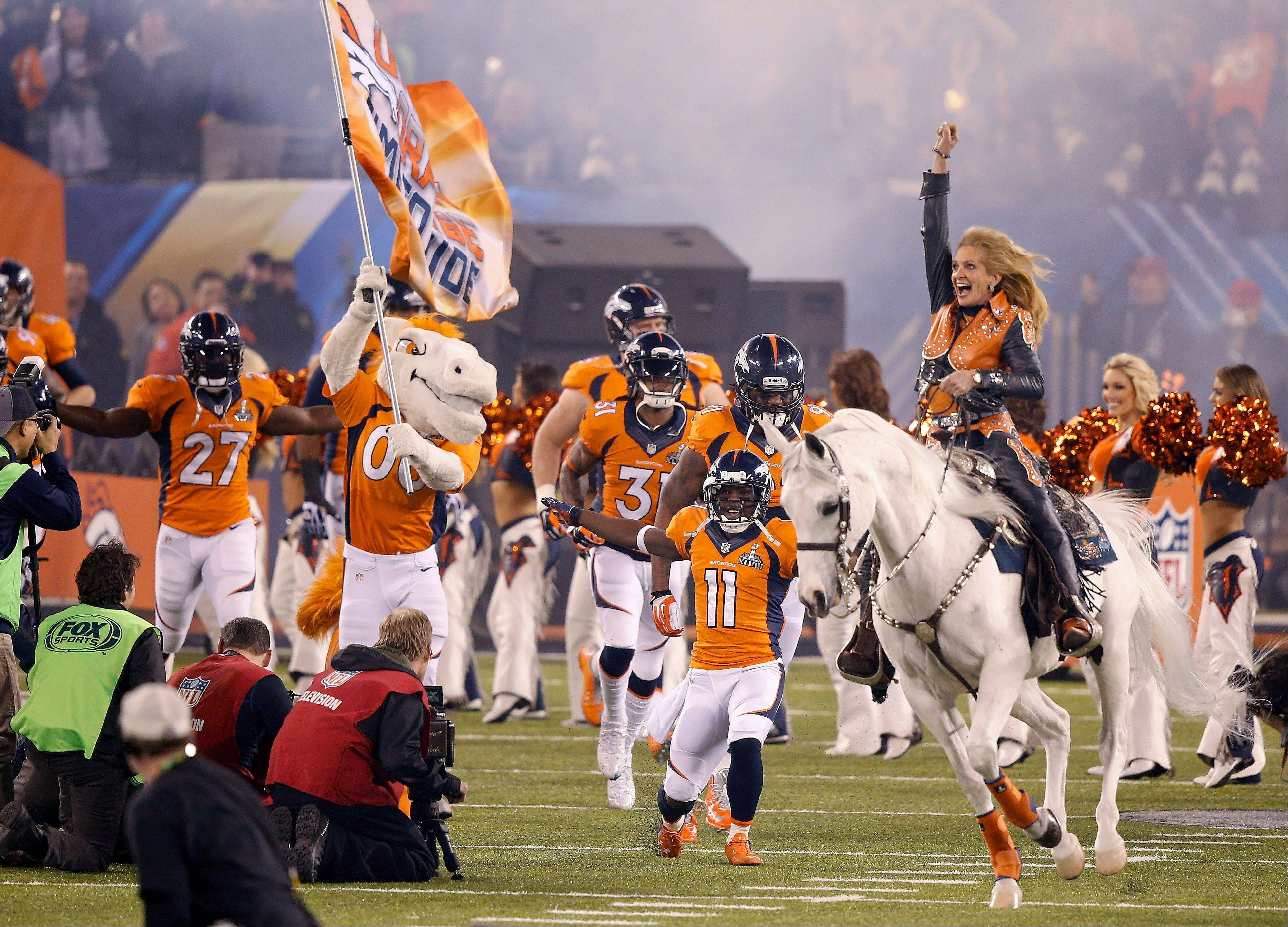 Thunder leads the Denver Broncos players onto the field before the NFL Super Bowl XLVIII football game.