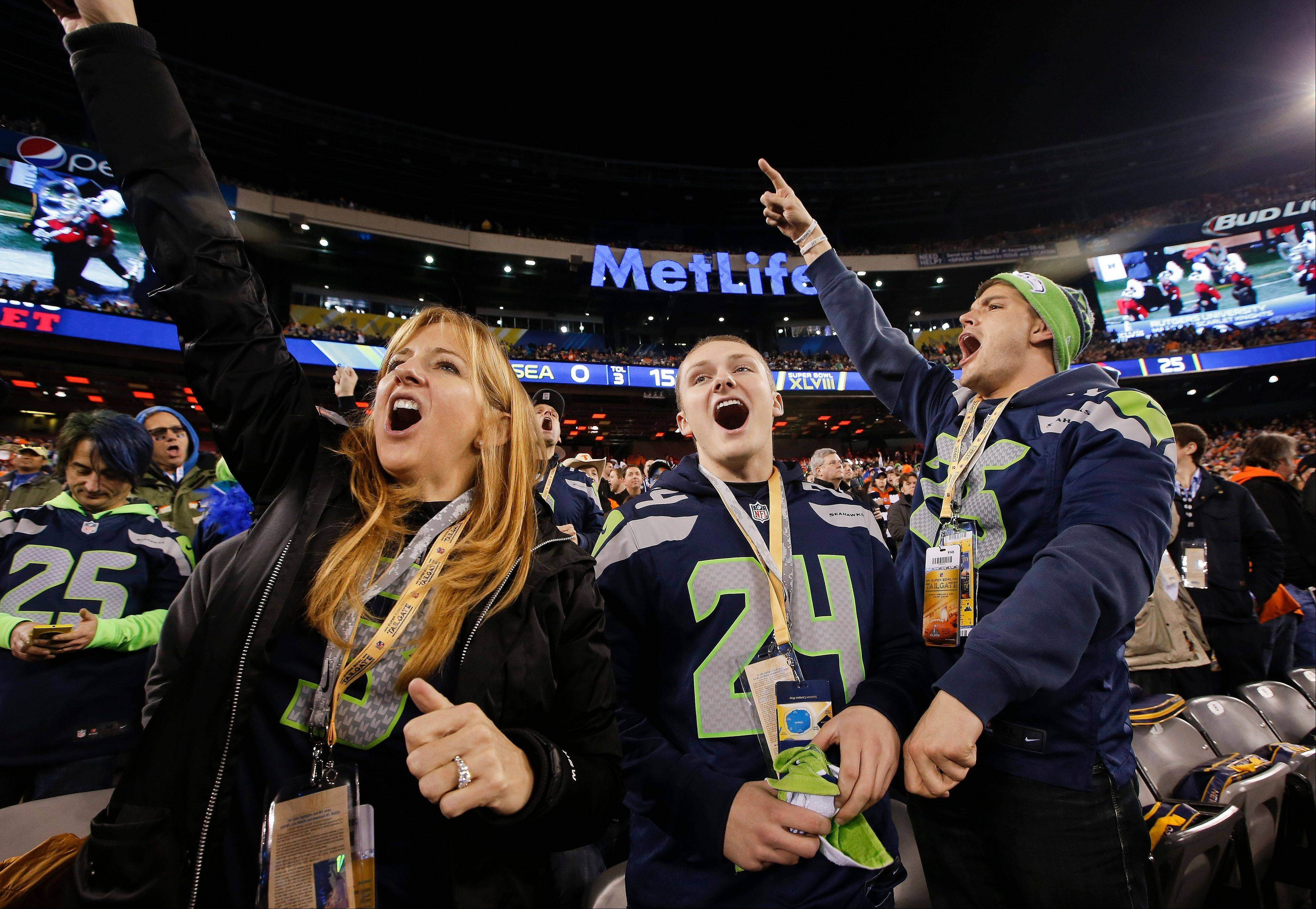 Seattle Seahawks fans cheer before the NFL Super Bowl XLVIII football game.