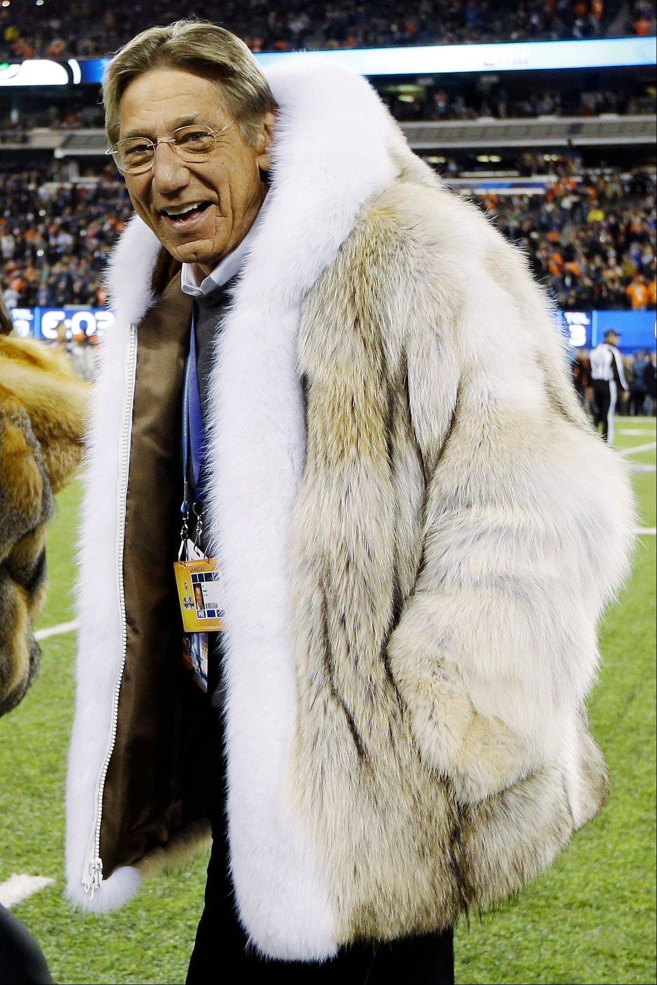 Former New York Jets quarterback Joe Namath walks on the field before the NFL Super Bowl XLVIII football game.