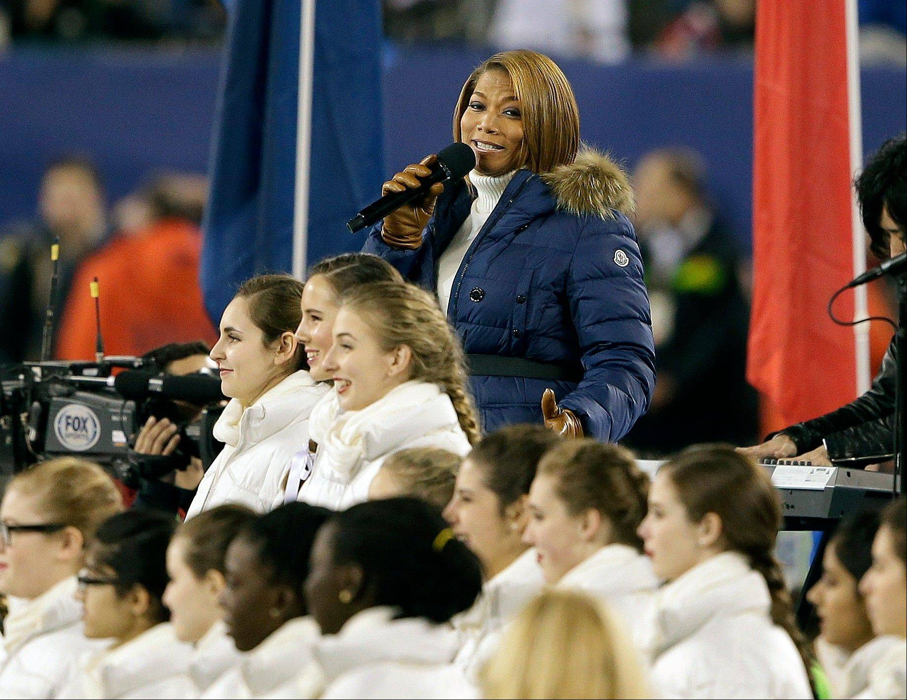 "Queen Latifah sings ""America the Beautiful"" before the NFL Super Bowl XLVIII football game."