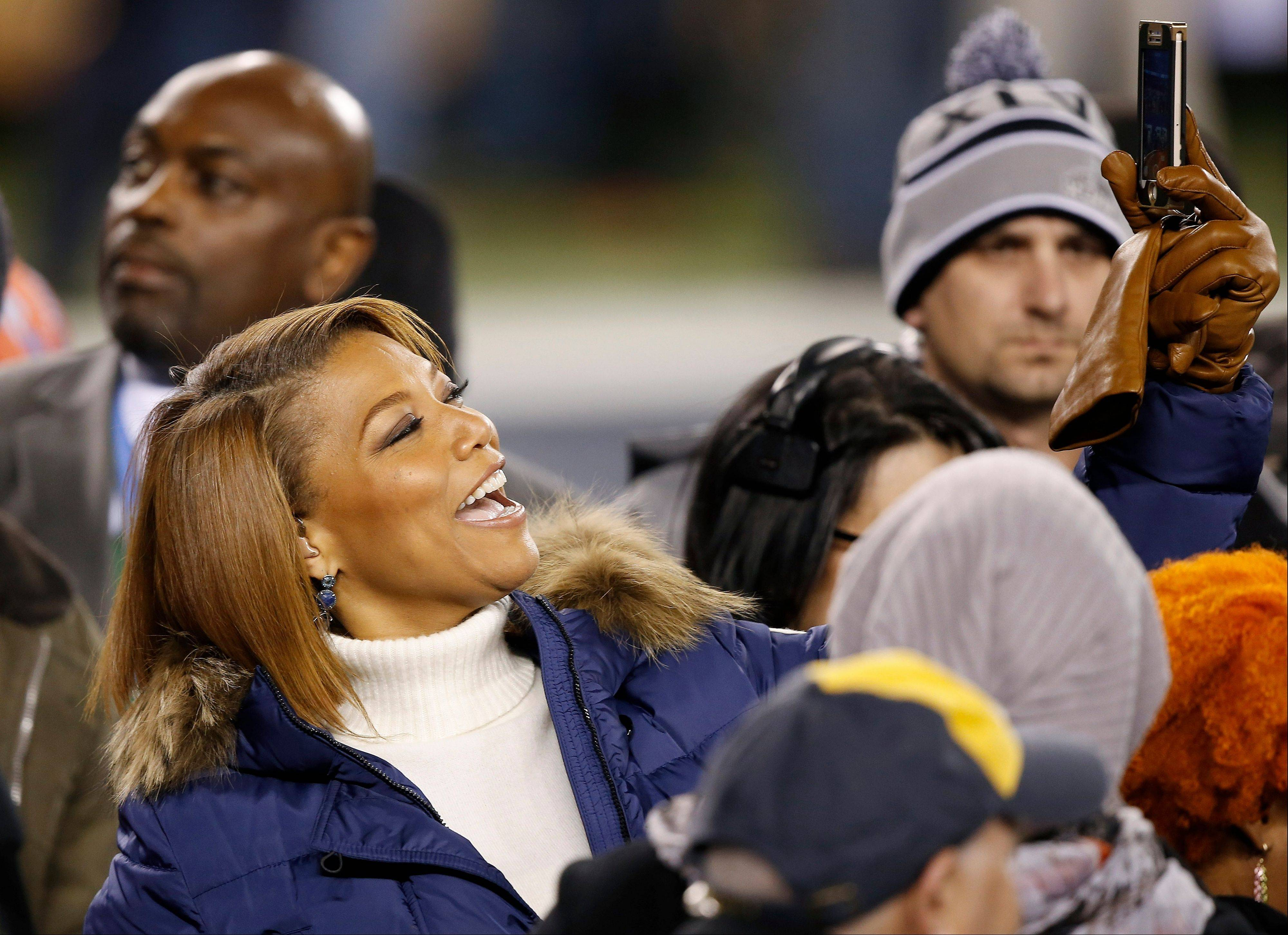 Queen Latifah arrives on the field before the NFL Super Bowl XLVIII football game Sunday.